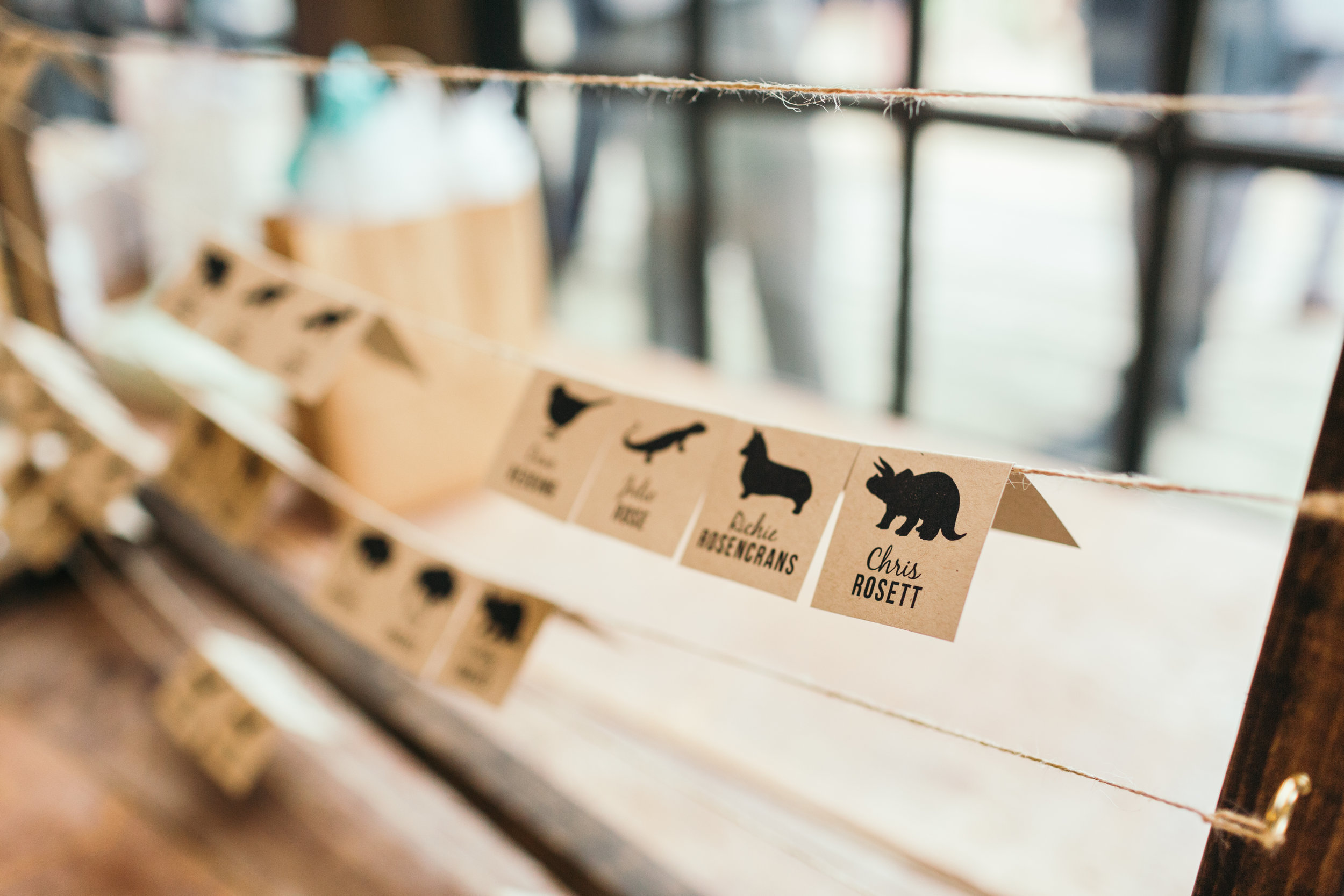 Rustic and creative place cards of animals instead of table numbers at Waterloo Village