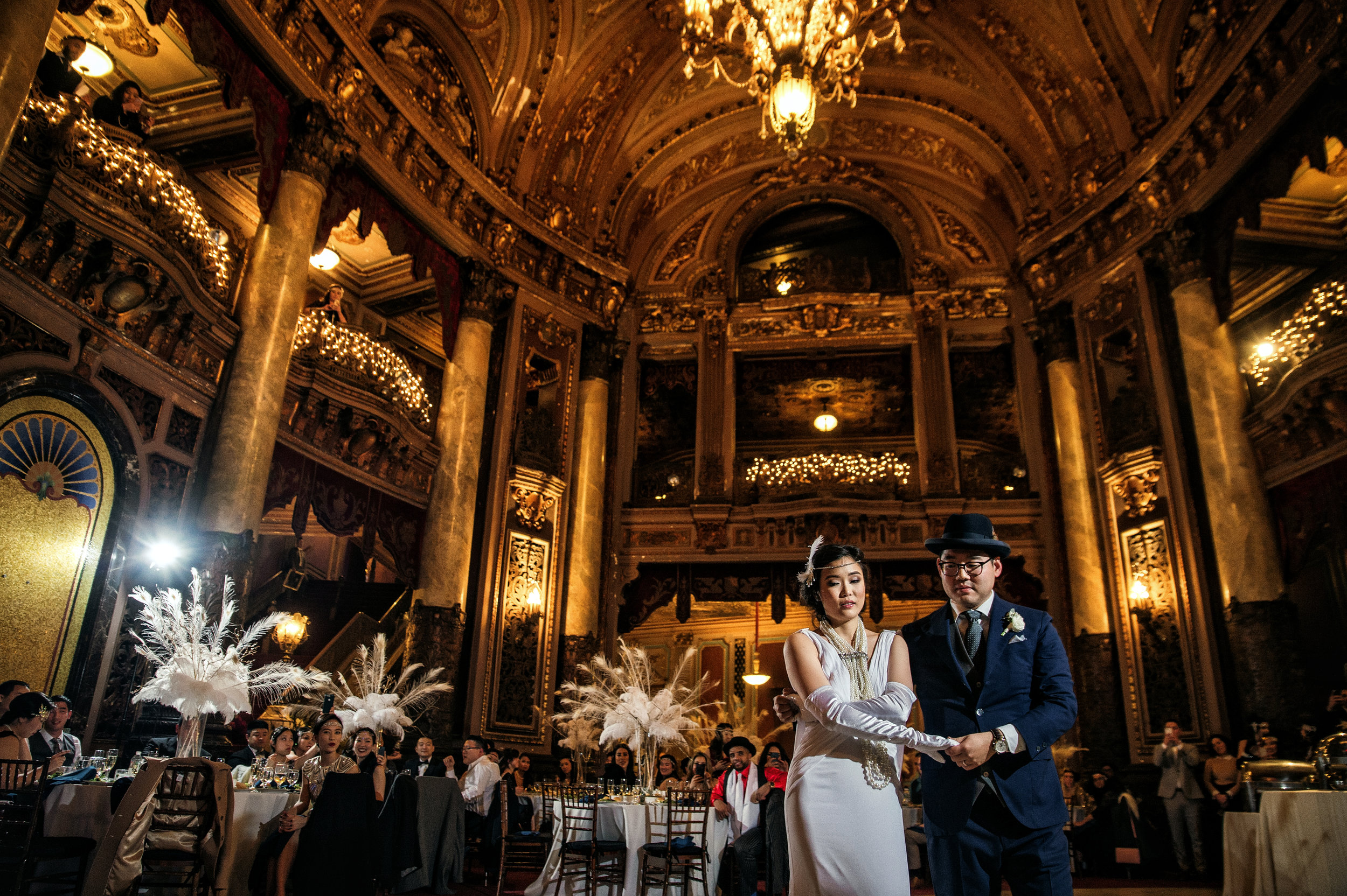 Beautifully picture of 20's Inspired bride and groom dancing at reception at historic Loew's Theater in Jersey City