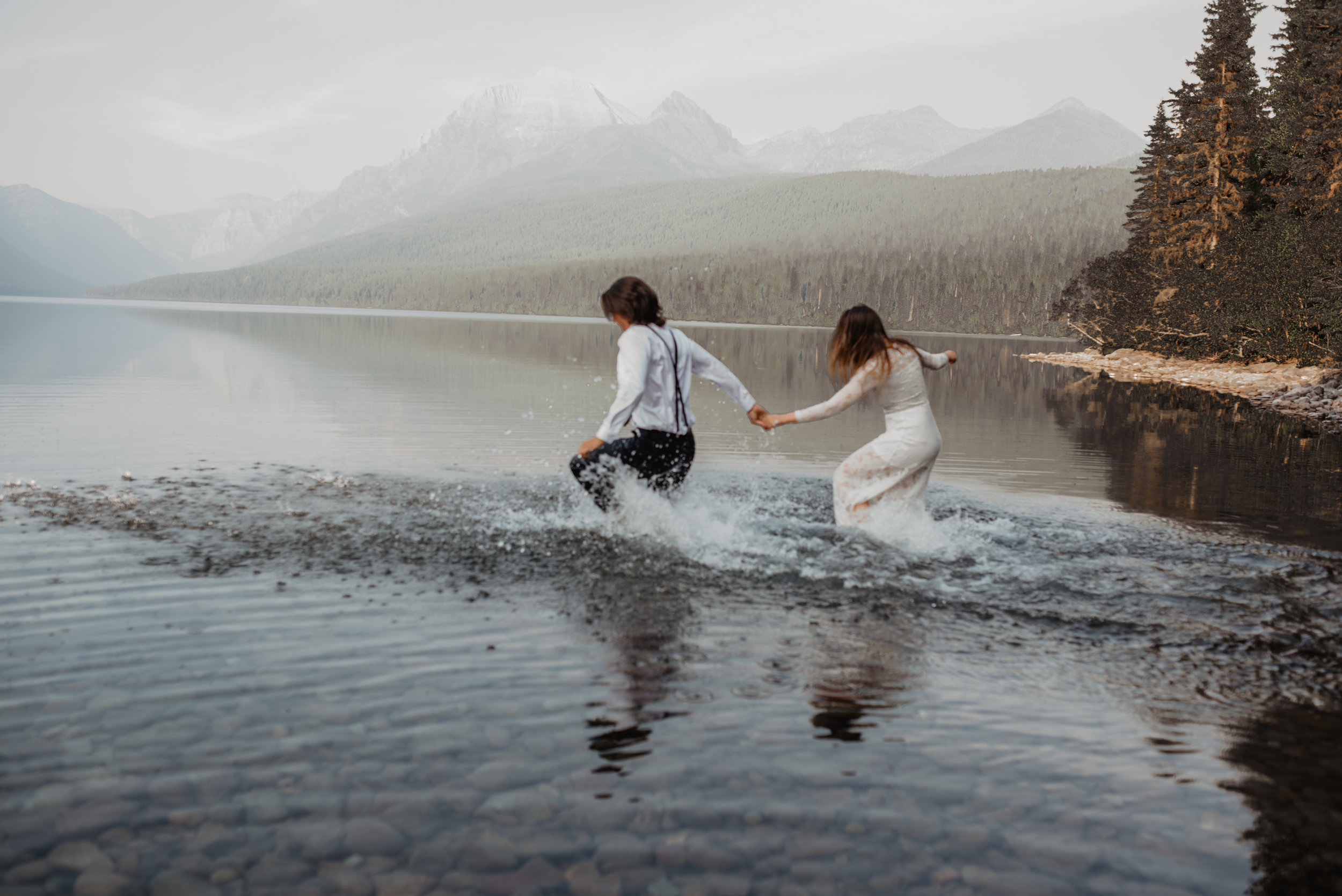 Hudson and Makayla Glacier National Park MT Renewable and Sustainable Outdoor Water Splashing Elopement Couple