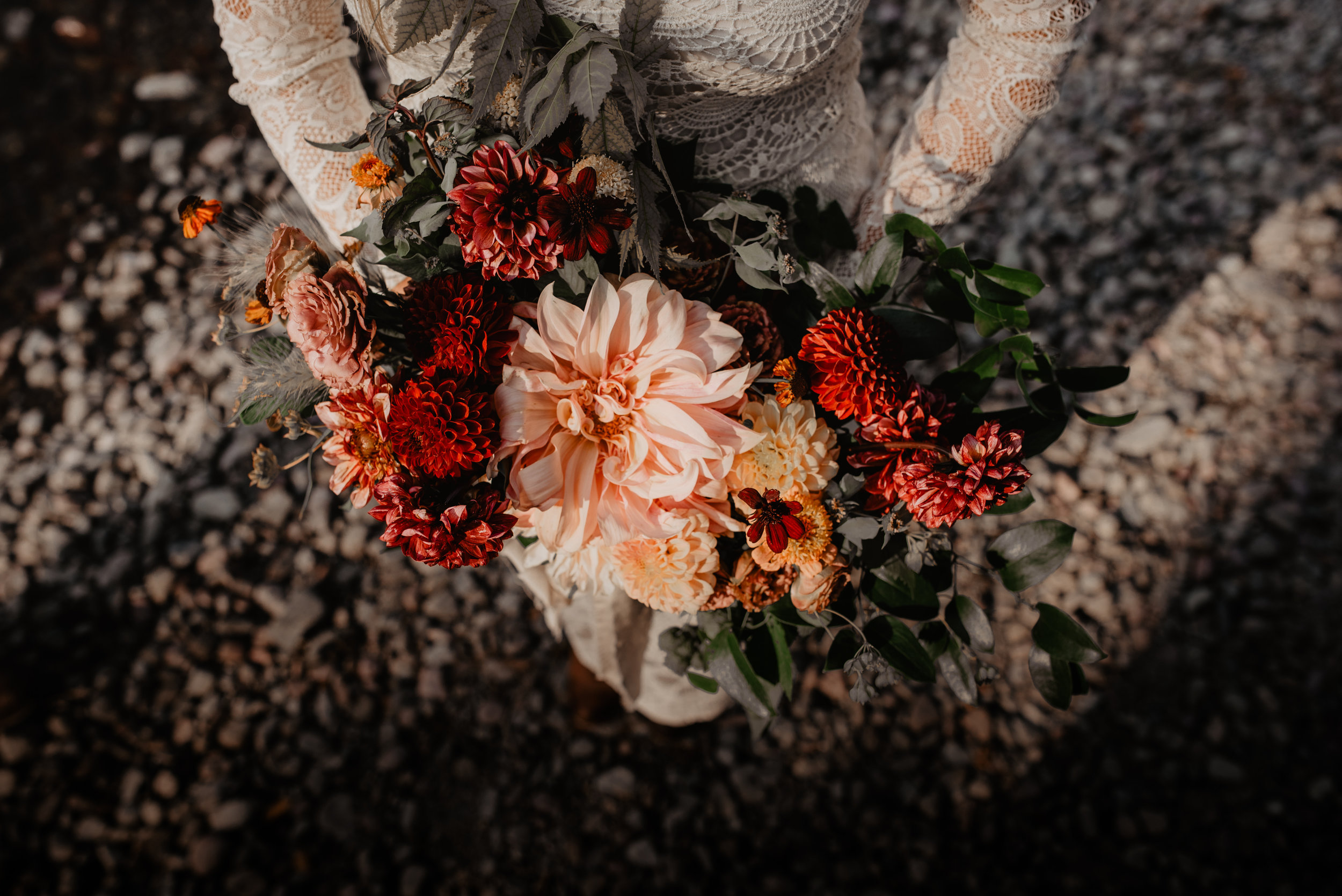 Local and ethically sourced wedding orange, red, green and peach flower bouquet