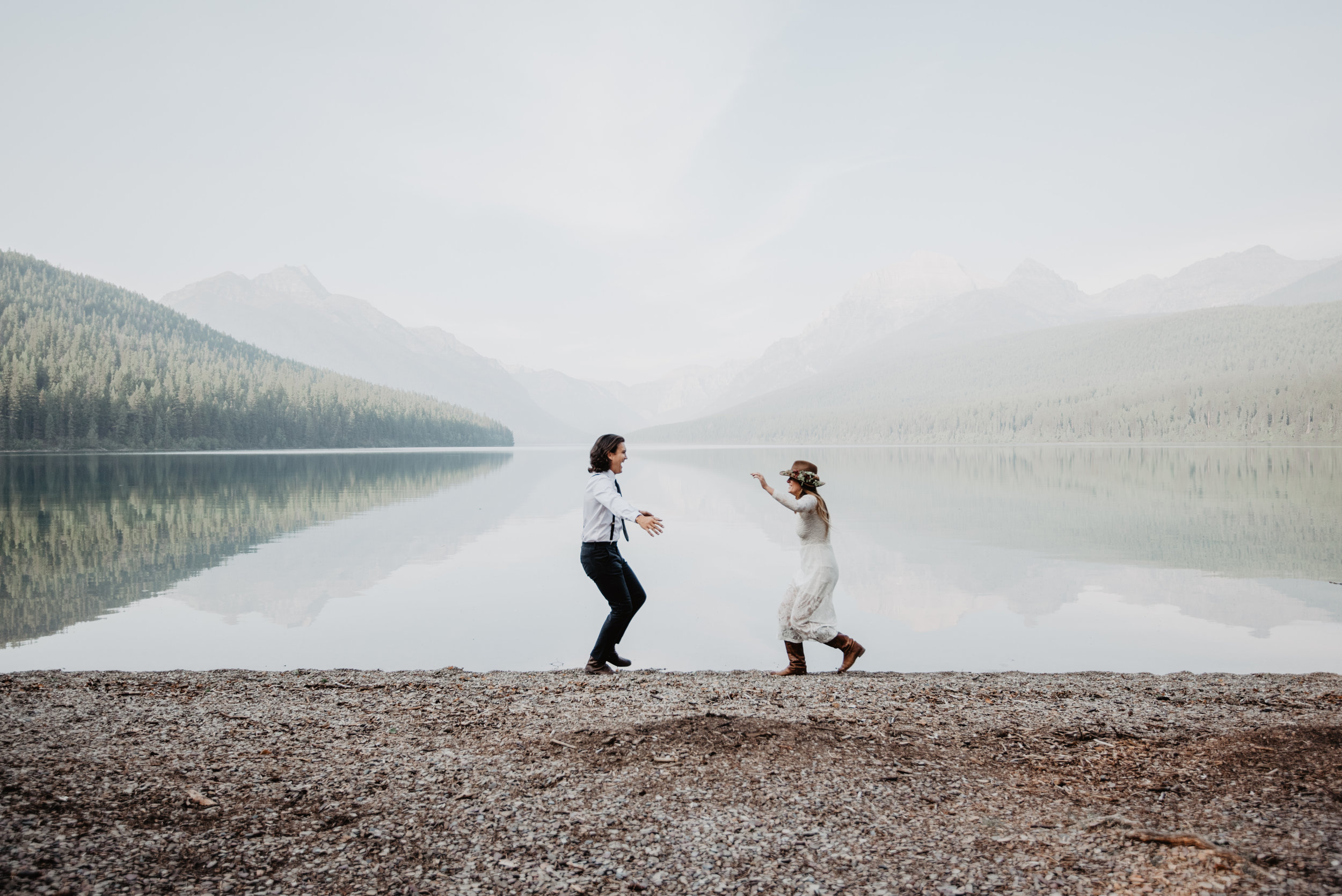 Outdoor sustainable elopement photo shoot of happy engaged couple at Glacier National Park MT