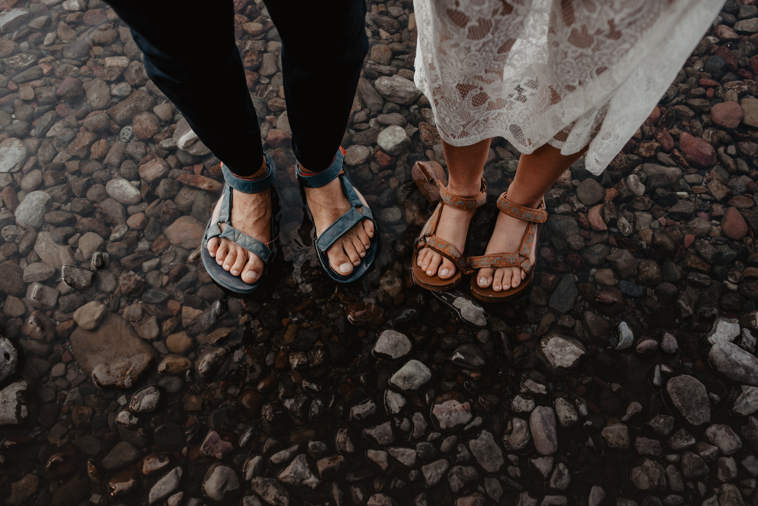 Photo of couple wearing matching shoes on a sustainable outdoor shoot at Glacier National Park MT