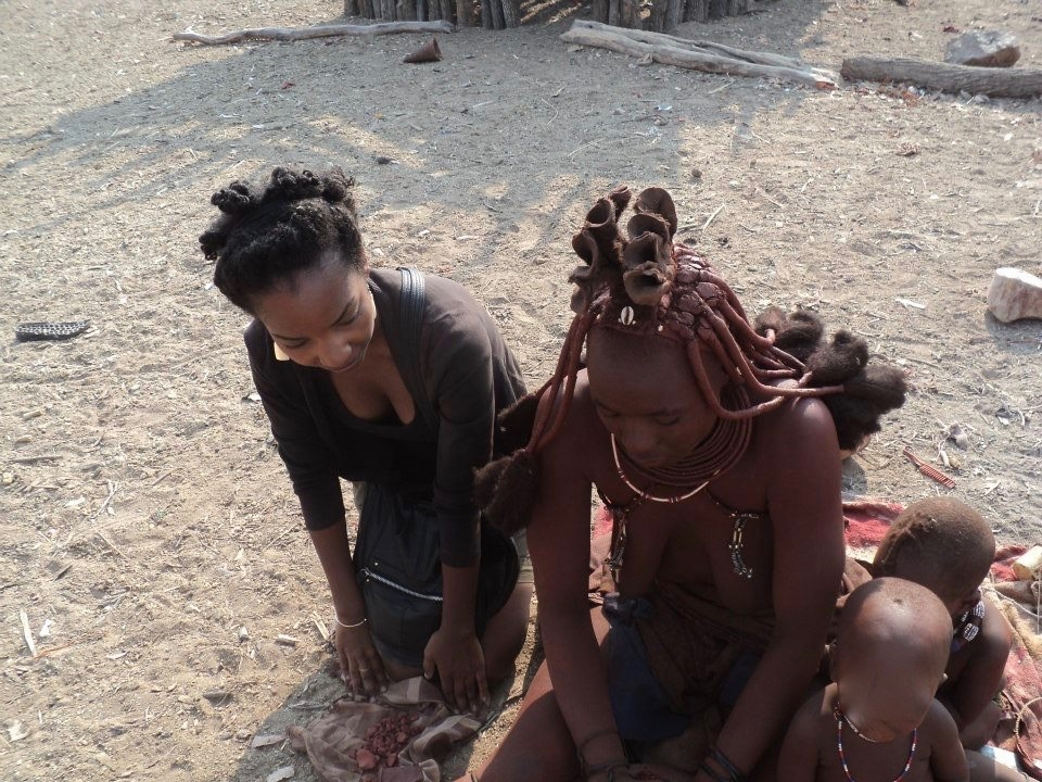 The author learning traditional paste making from a Himba woman.