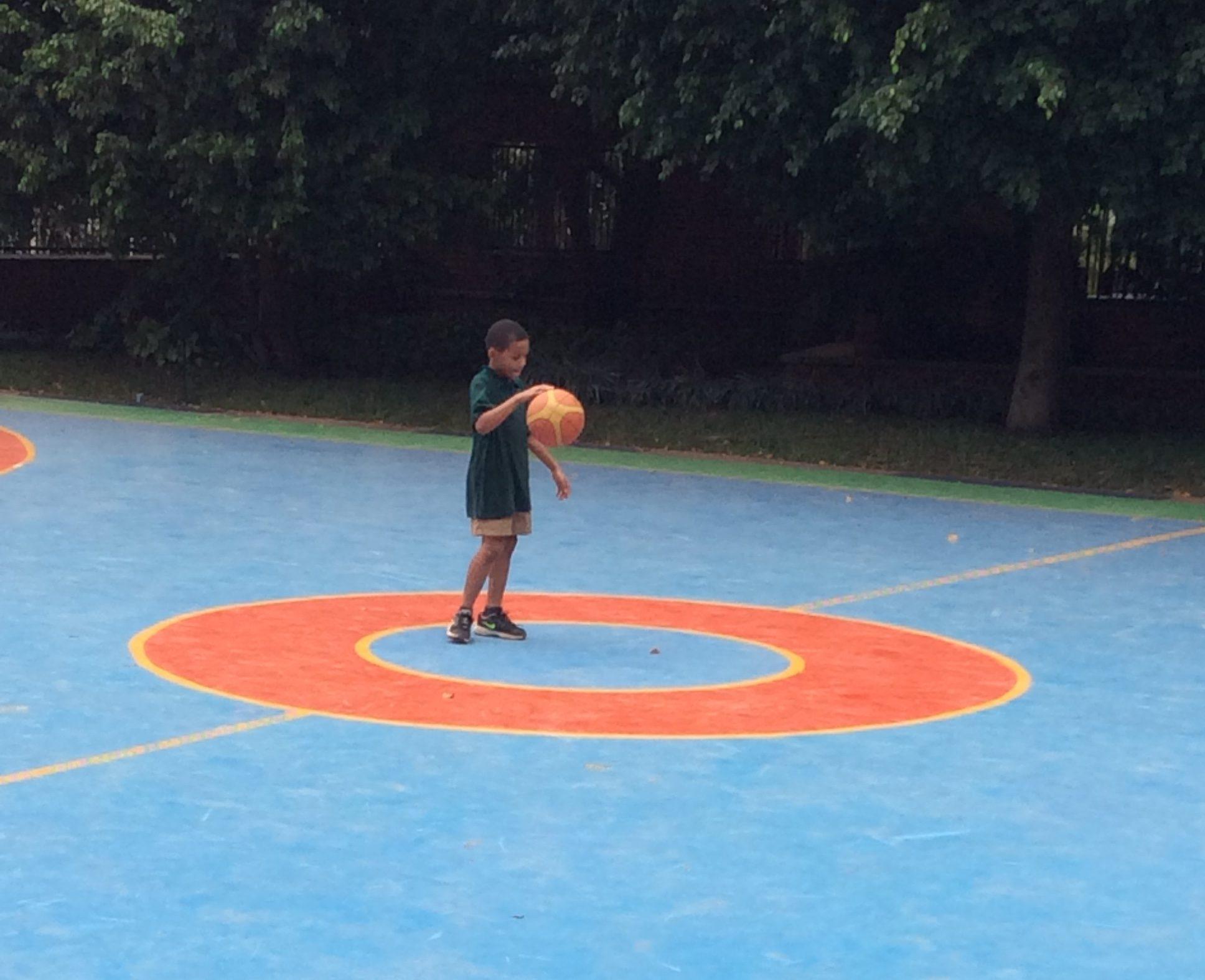 Kristen's son shooting some hoops.