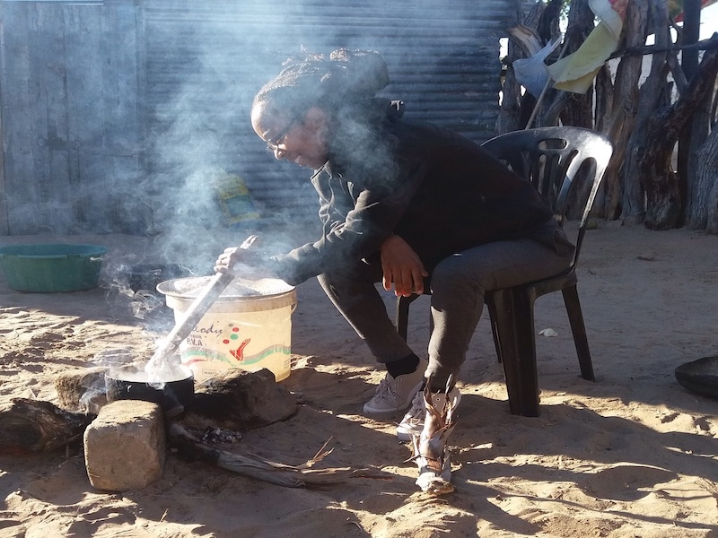 The author cooking over a fire in a northern Namibian village.