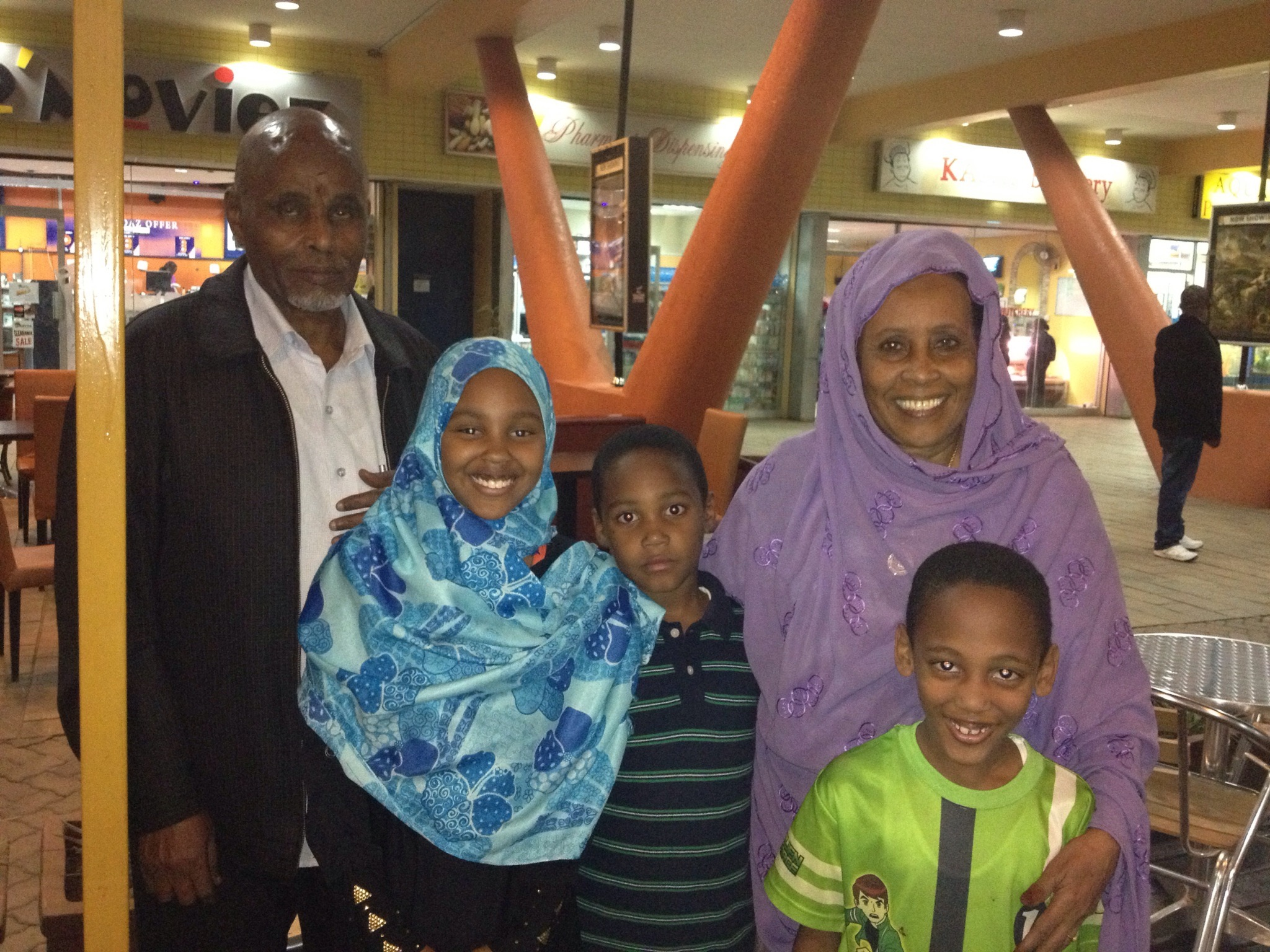 Pamela's children with their grandparents visiting from Canada at a local Kenyan mall.
