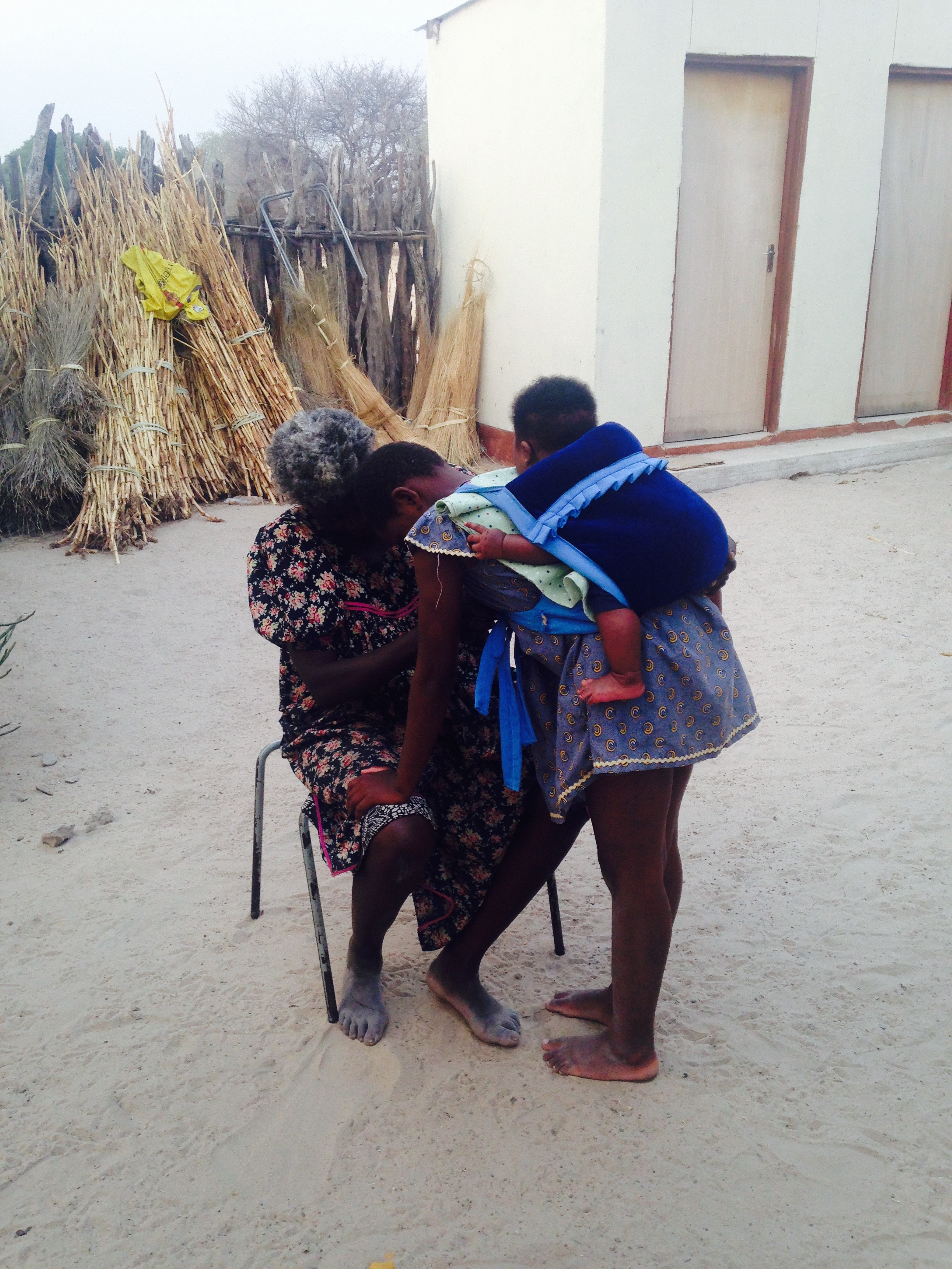 My son being tied on his cousin's back by his Namibian grandmother.