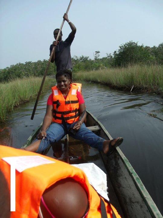 Latoya canoeing through Ghana's Nzulezo village!