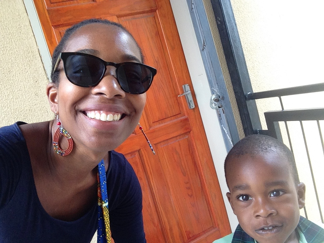 The author donning Warby Parker sunglasses with her son.