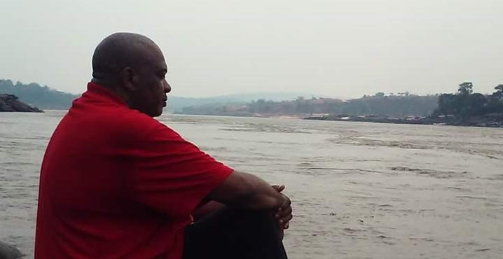 Dewey Boyd overlooking the Congo River at Mbudi Nature Reserve.