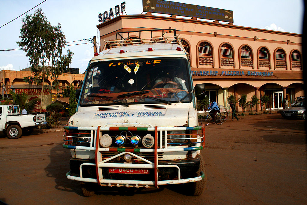 A minibus driving through Bamako City Center, Mali. Credit: Jelle Jansen , Bamako Boulangerie , CC BY 2.0