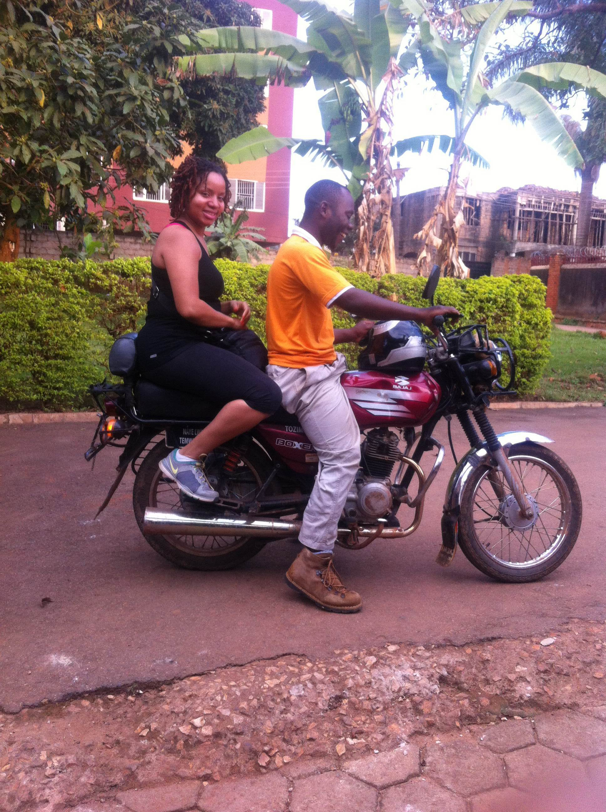 Kristen Woodruff catching a ride through Kampala on a local  boda boda  (motorcyle taxi).