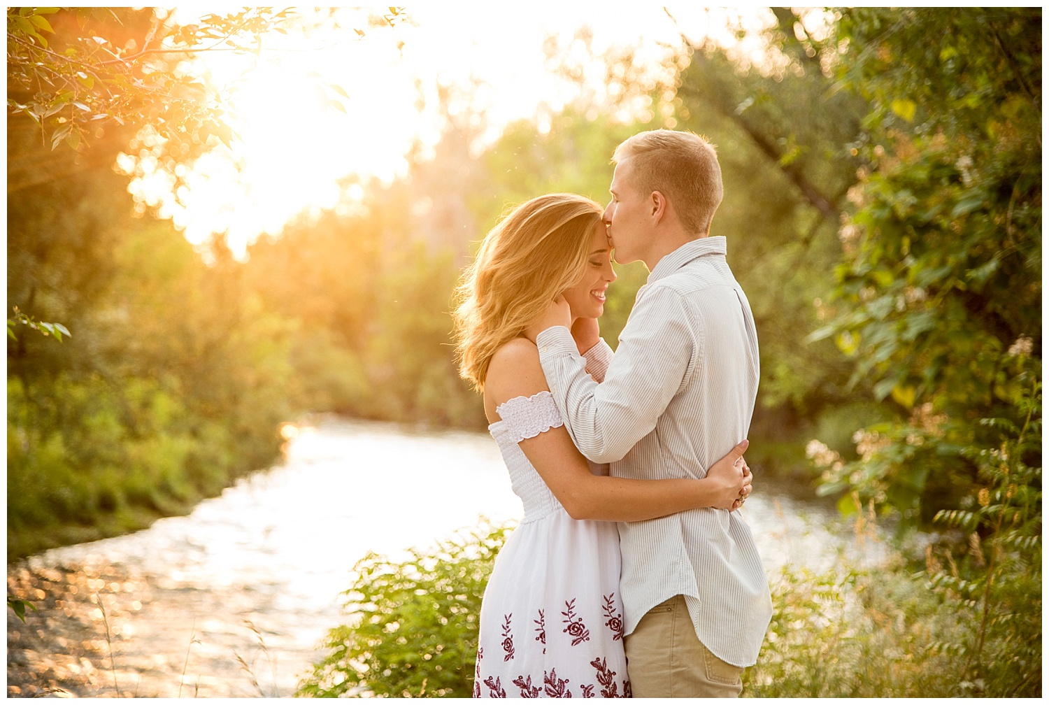 Man Kissing Young Woman on Forehead During Sunset | Mike and Allison's Intimate Engagement Session | Clear Creek, Arvada, Colorado | Farm Wedding Photographer | Apollo Fields Wedding Photojournalism