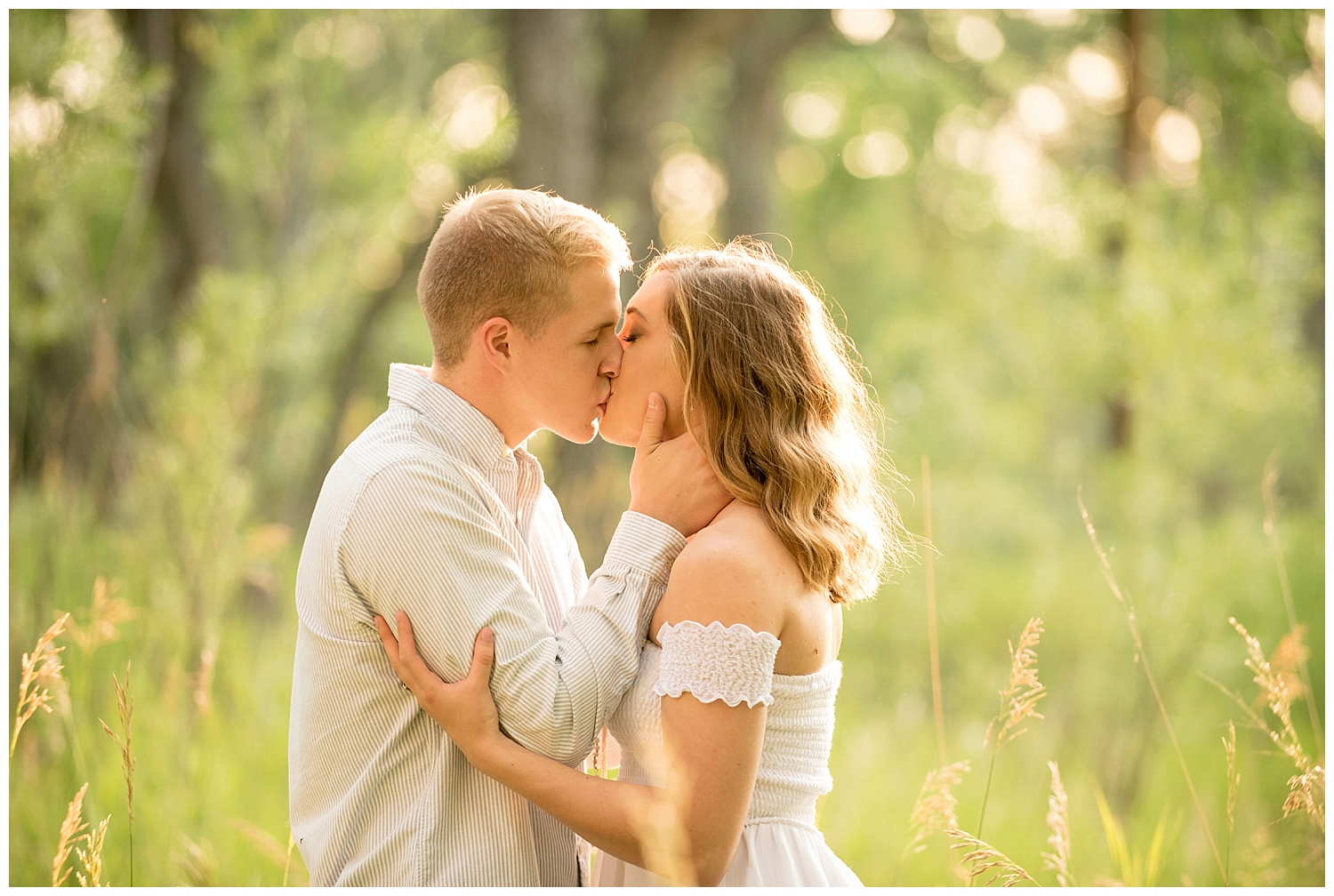 Young Couple Kissing in the Grass during Sunset | Clear Creek, Arvada, Colorado | Farm Wedding Photographer | Apollo Fields Wedding Photojournalism