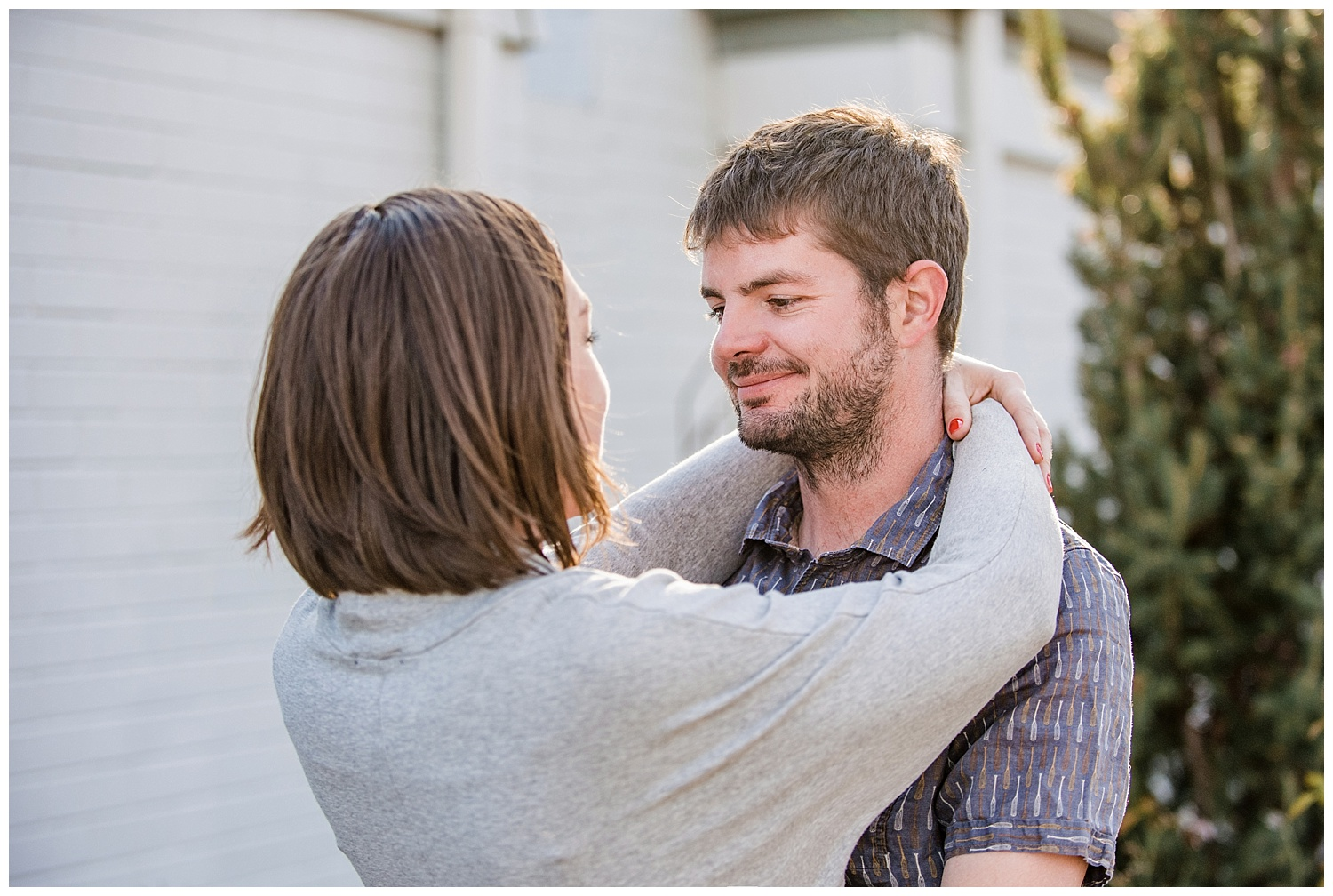 Woman hugging man | Kerry and Patrick's Intimate in home engagement session | Sloans Lake Colorado Photography | Farm Wedding Photographer | Apollo Fields Wedding Photojournalism