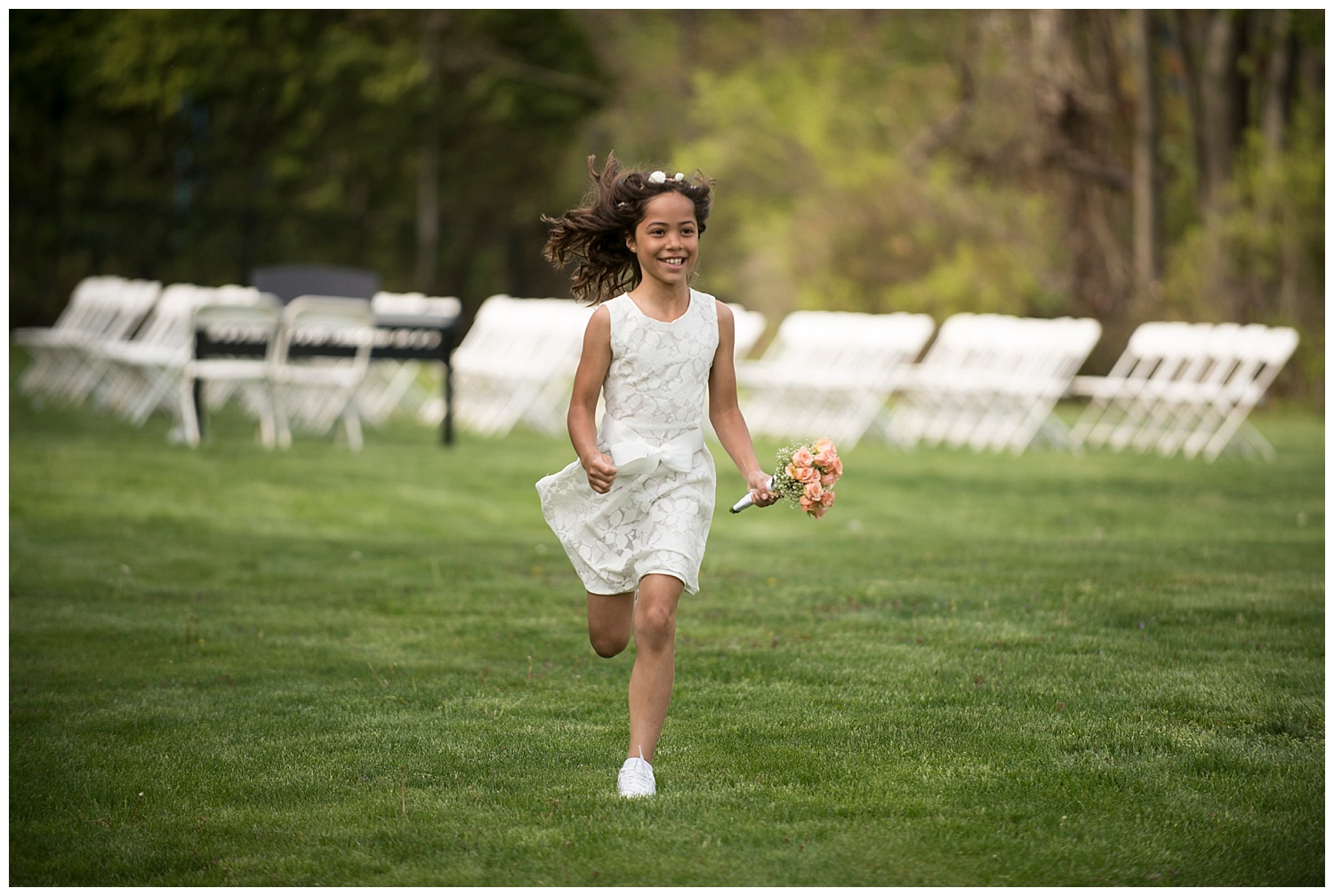 Flower Girl Running | Intimate Wedding Photographer | New York State Wedding Photographer | Farm Wedding Photographer | Apollo Fields Wedding Photojournalism