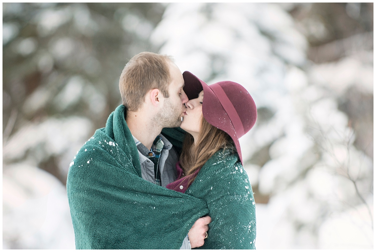 Man Kissing Woman in blanket in Snow | Breckenridge Engagement Photography | Colorado Engagement Photographer | Farm Wedding Photographer | Apollo Fields Wedding Photojournalism