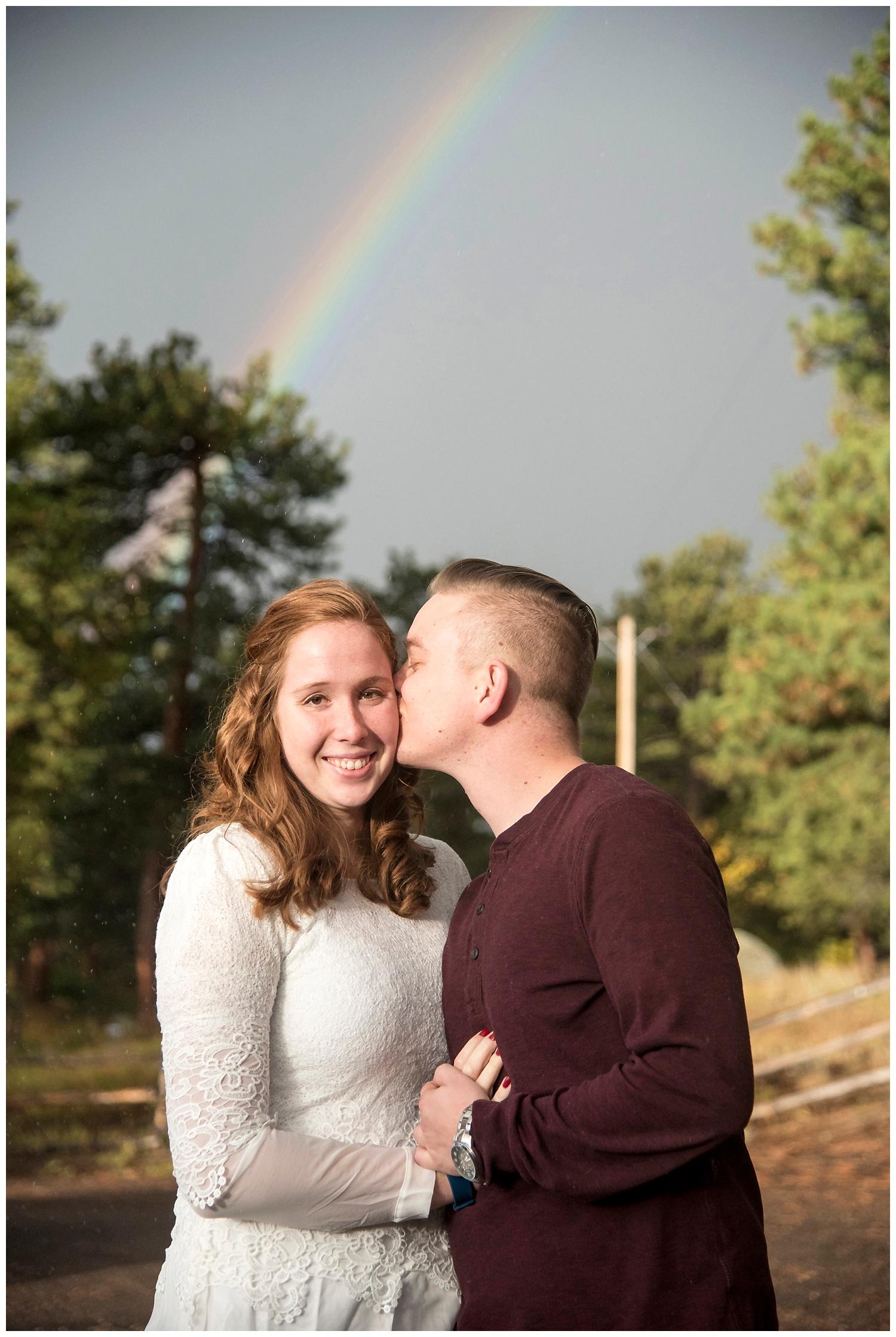Man Kissing Woman with Rainbow | Don & Aliyah's Mountain Engagement Photography | Farm Wedding Photographer | Apollo Fields Wedding Wedding Photojournalism