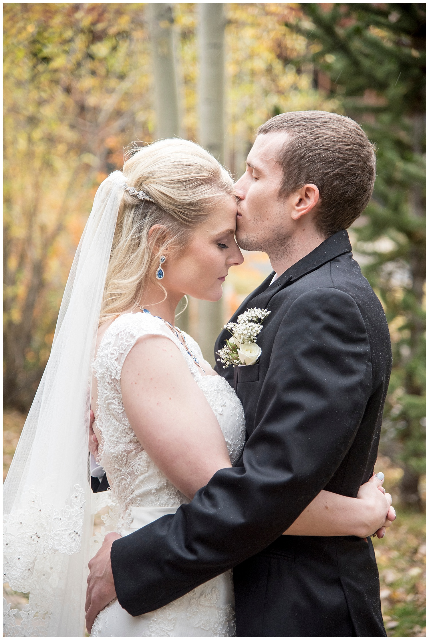 Groom Kissing Bride on Forehead | Chris & Destiny's Destination Wedding | Breckenridge Wedding Photographer | Colorado Farm Wedding Photographer | Apollo Fields Wedding Photojournalism
