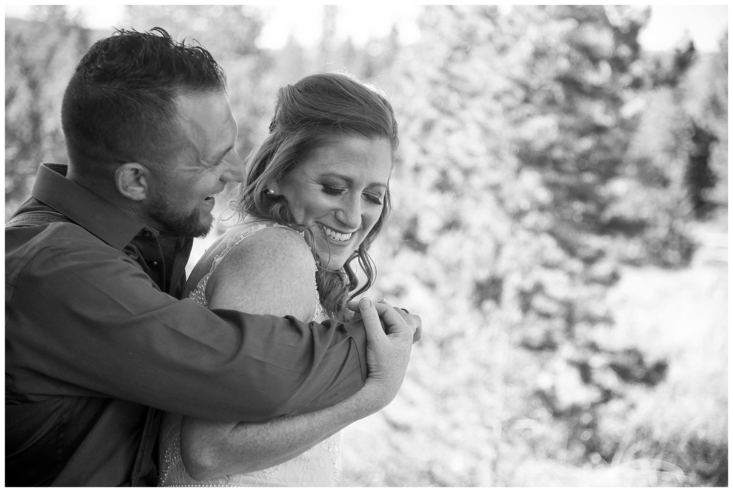 Black and White Bride and Groom Smiling | Carolyn and Shawn's Wild Horse Inn Wedding at Devil's Thumb Ranch | Fraser Colorado Photography | Farm Wedding Photographer | Apollo Fields Photojournalism