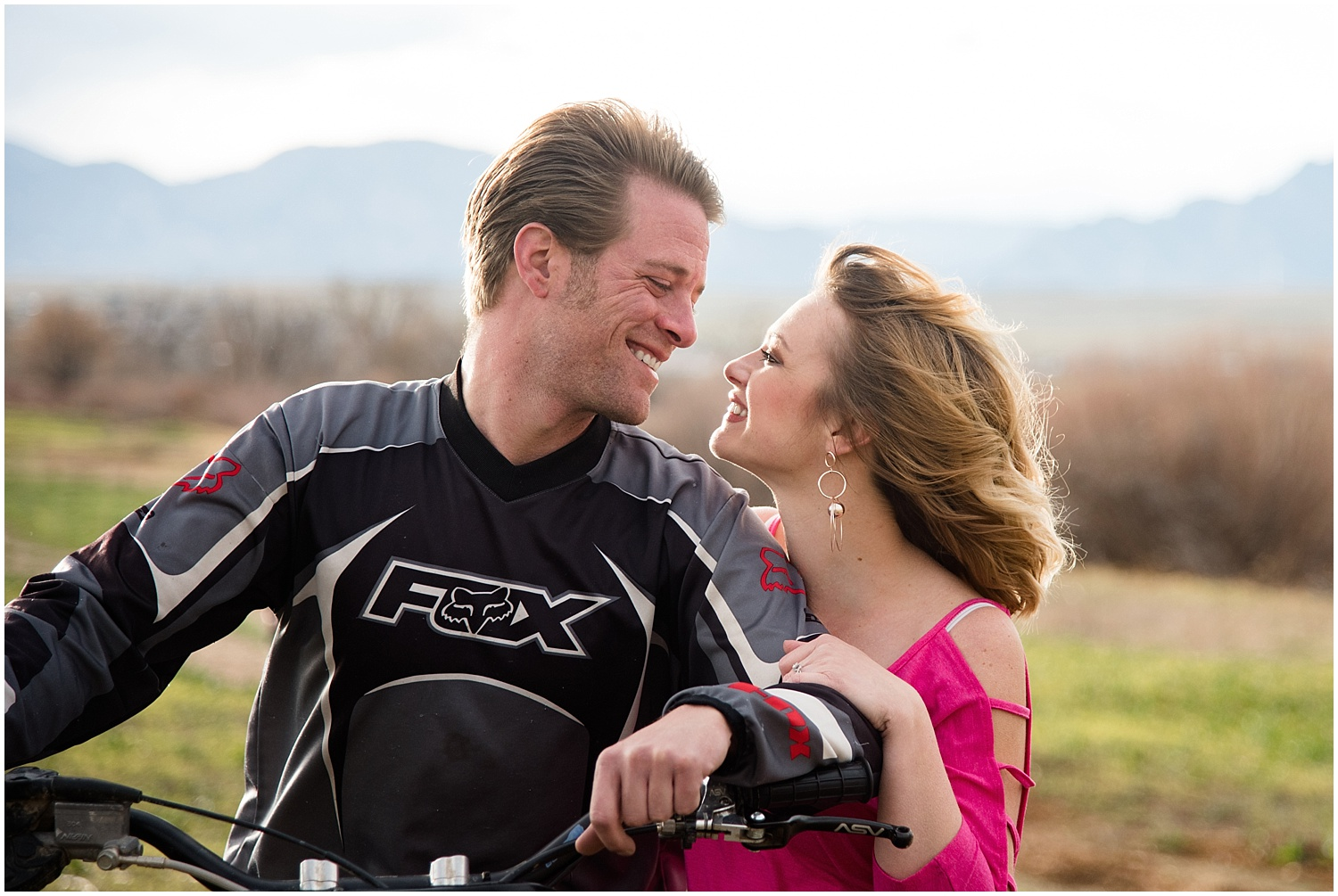 Man on Dirt Bike Looking into Woman's Eyes |Dirt Bike Engagement Session | Standley Lake Photographer | Rocky Mountain Elopement Photography | Farm Wedding Photographer | Apollo Fields Photojournalism