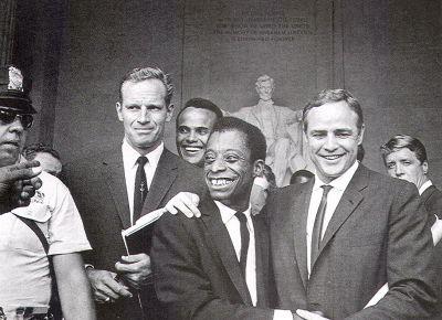 Charlton_Heston__Harry_Belafonte__James_Baldwin_and_Marlon_Brando_at_the_March_on_Washington.jpg