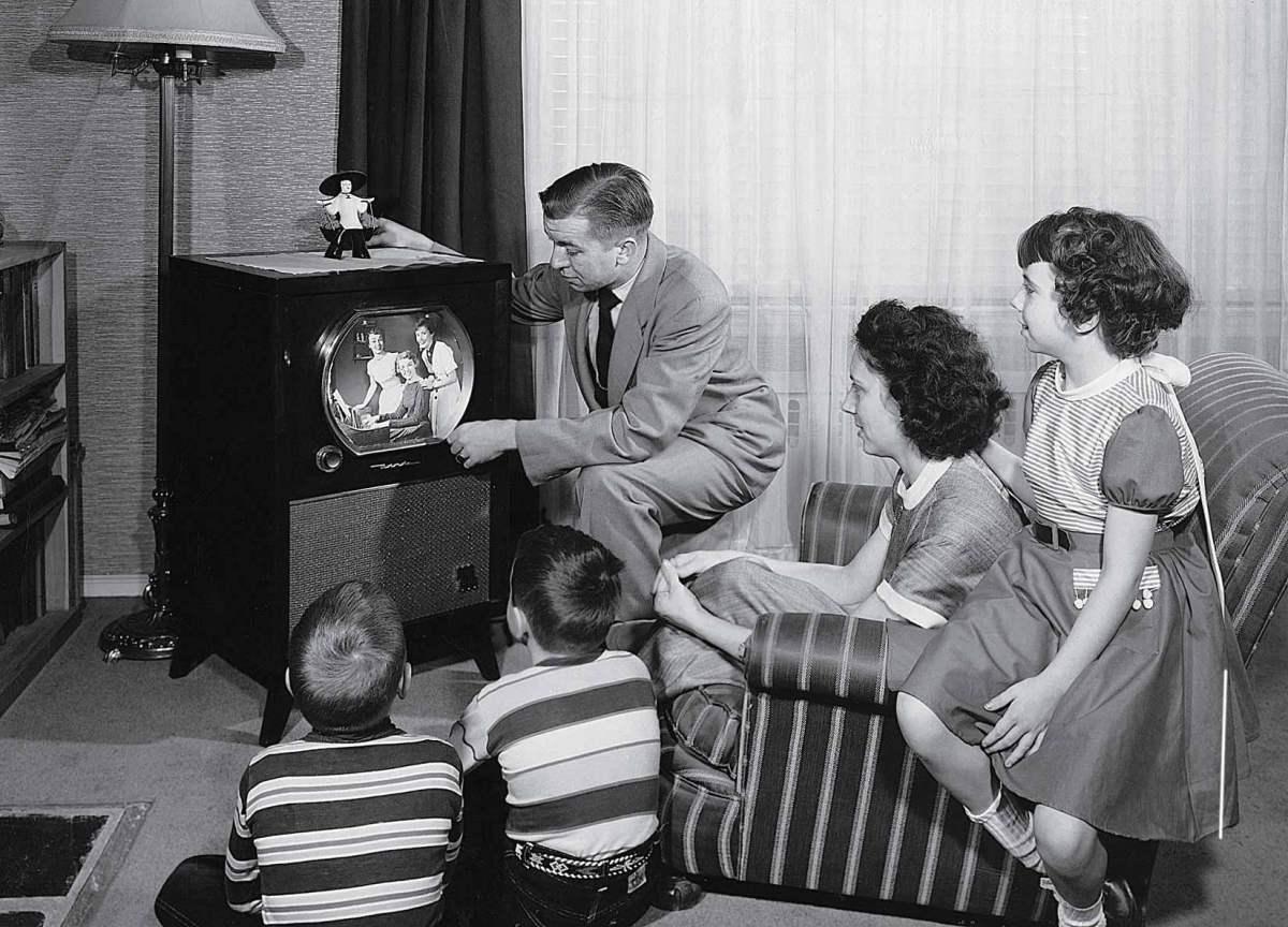 parents-with-three-children-watching-television.jpg