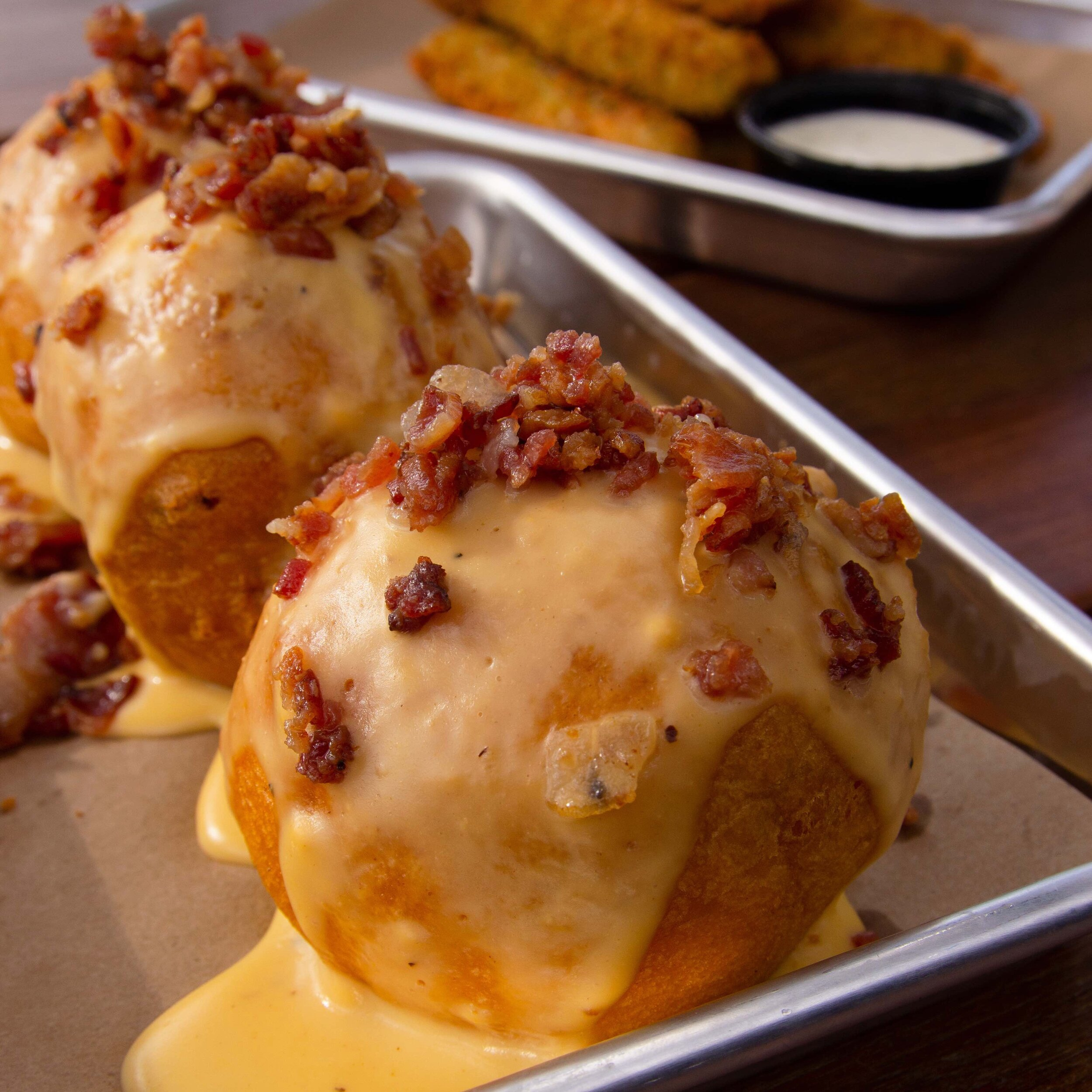 BEAR BALLS - 3 for $6  Mac & cheese, cornbread and pulled pork. Batter and fired. Topped with cheese sauce and Bacon