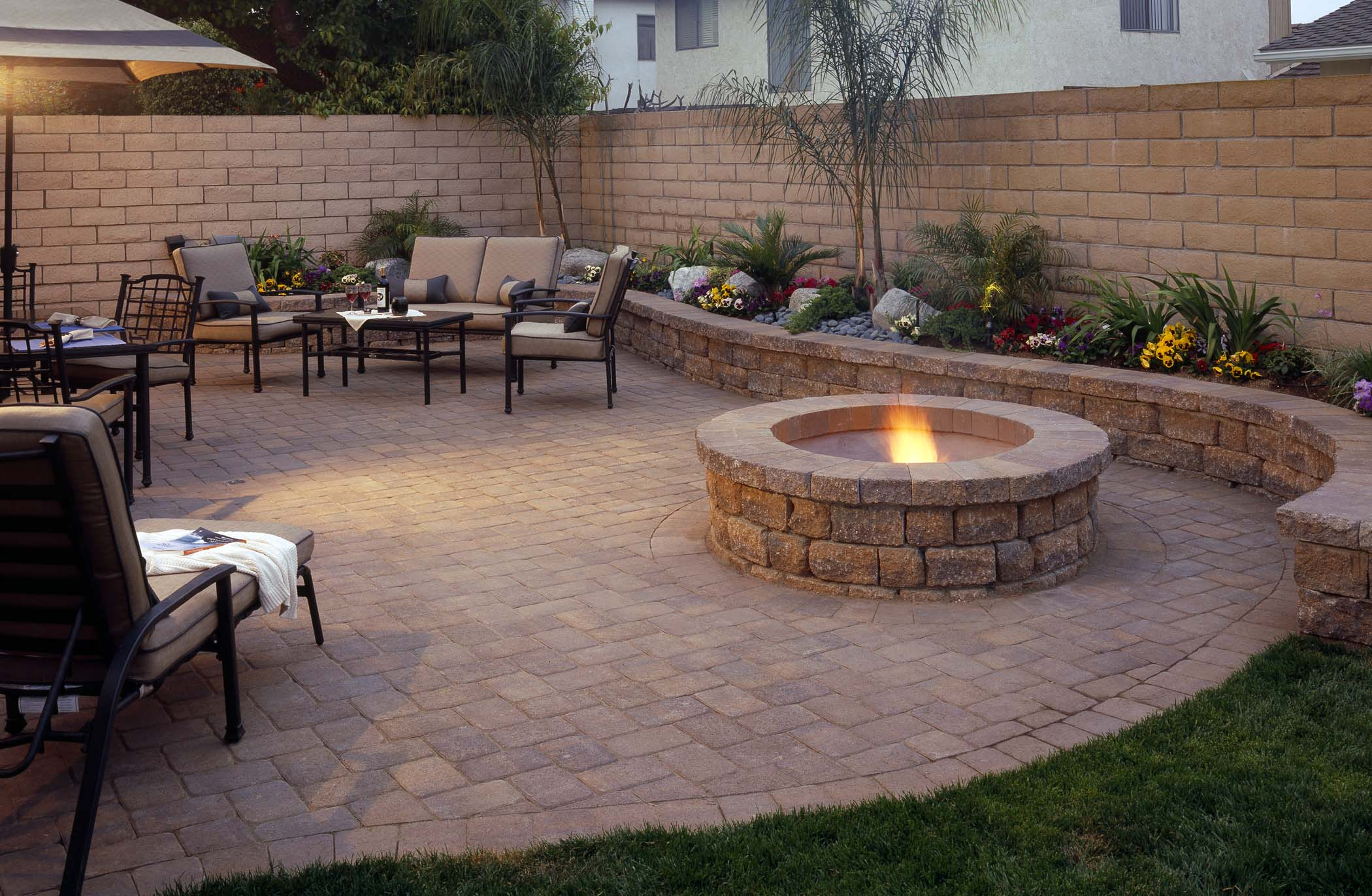 Upgrade your backyard with a beautiful fire pit for family outings.