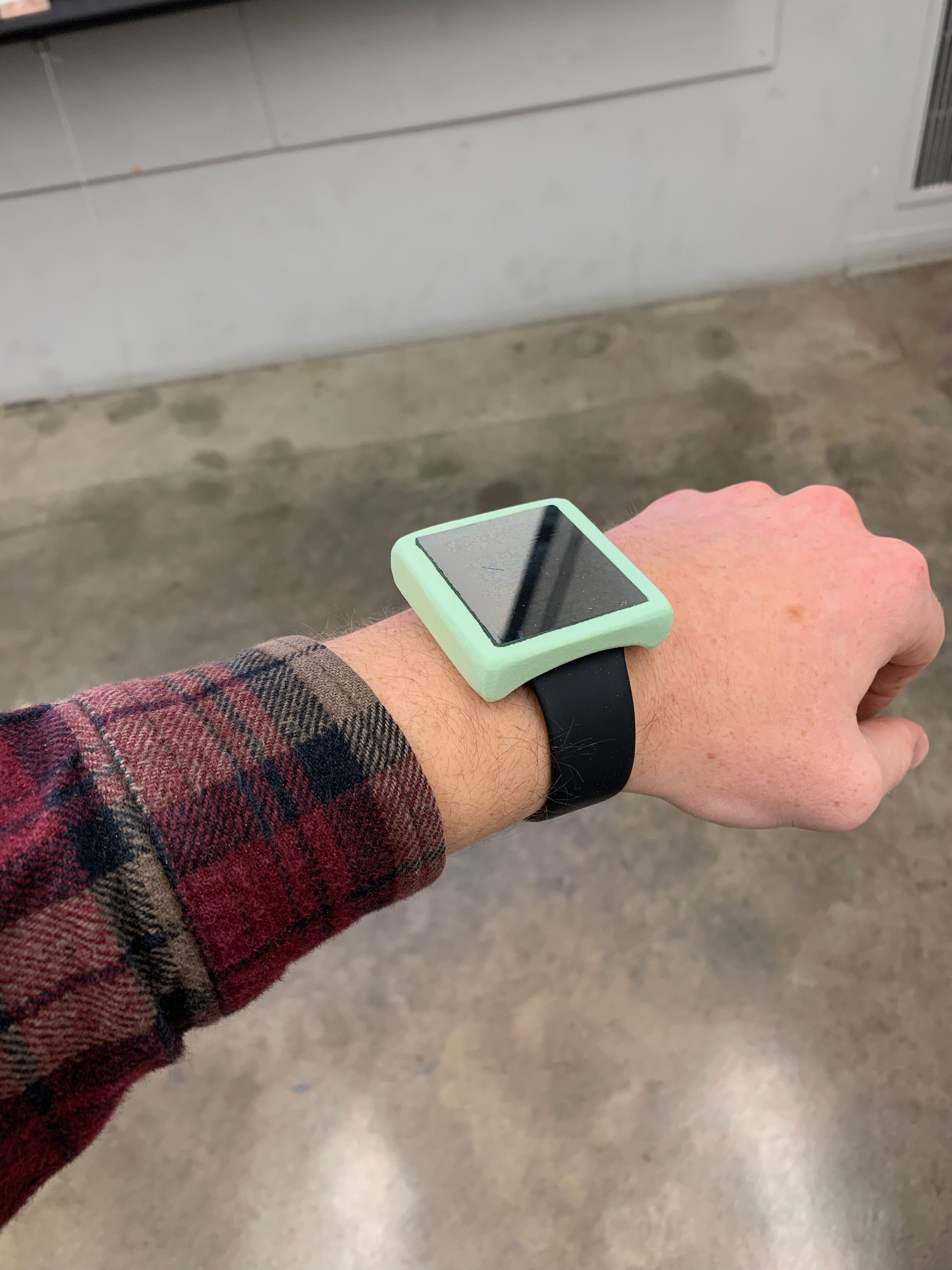 The final high-fidelity wizard-of-oz prototype. A foam casing and plastic two-way mirror on top of an Apple Watch.