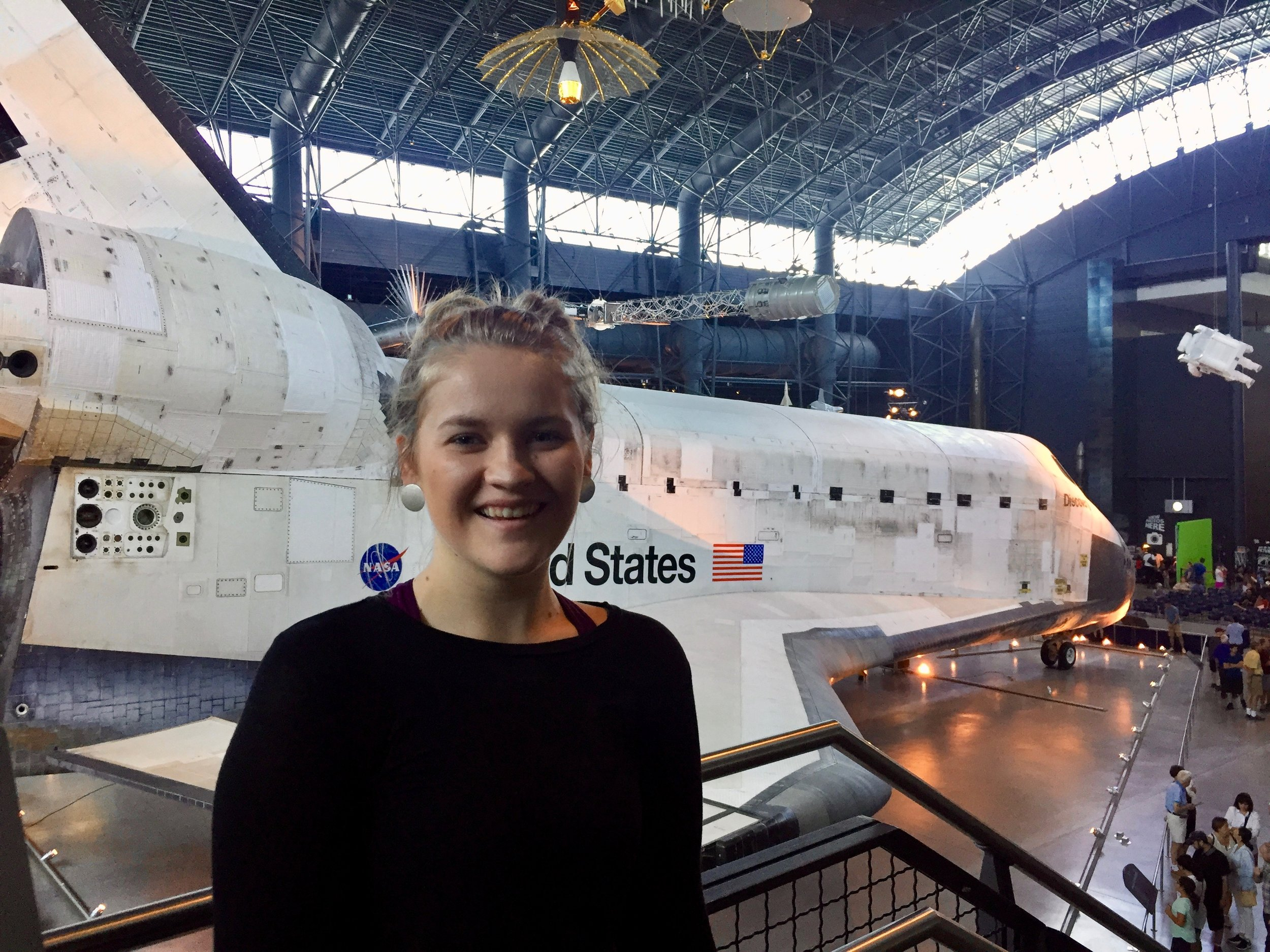 Me in front of the space shuttle Discovery at the  Smithsonian National Air and Space Museum