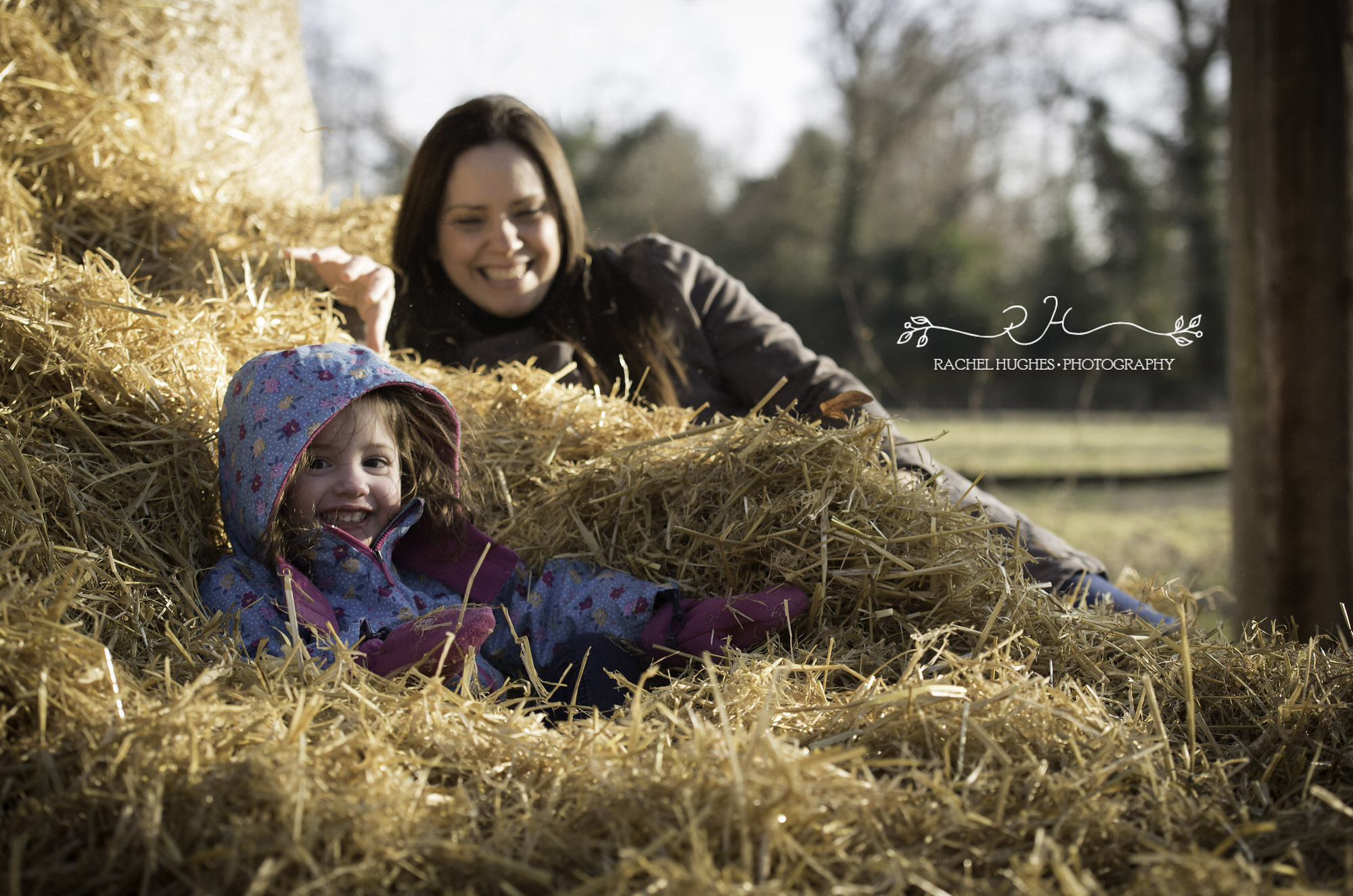 Girl and mummy in haystack