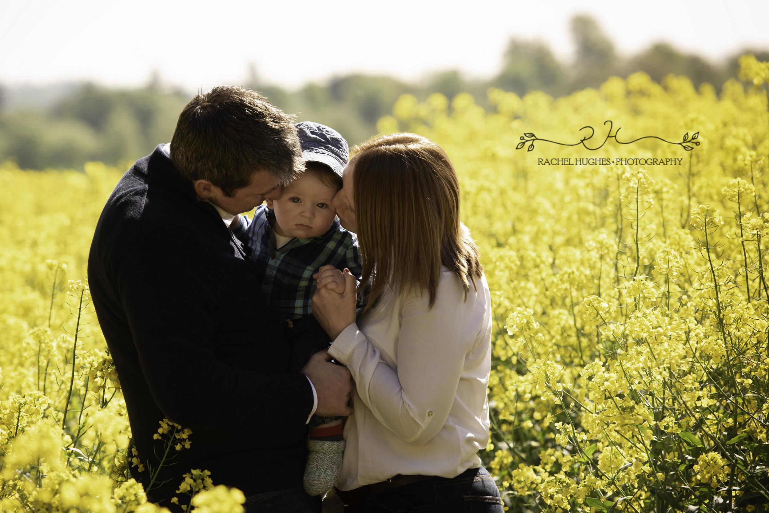 Family in rapeseed oil flowers in Henley