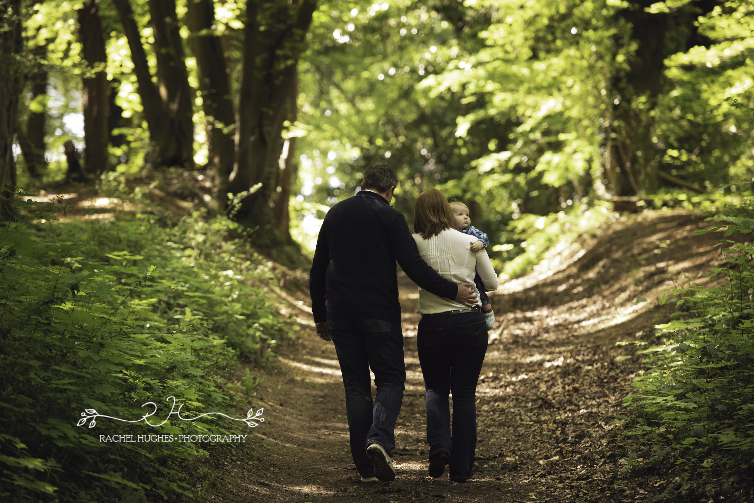 Family walking in wood in Henley-on-Thames
