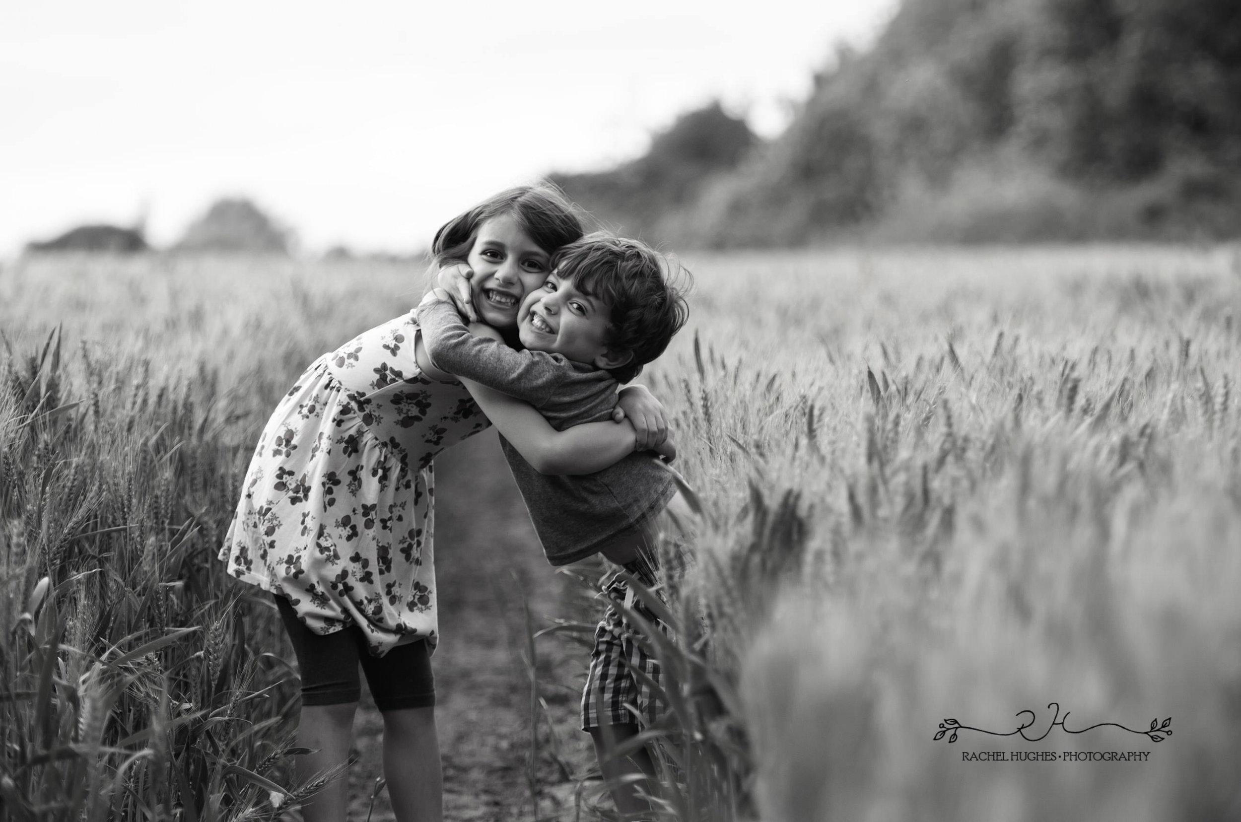 Jersey photographer - siblings hugging in cornfield