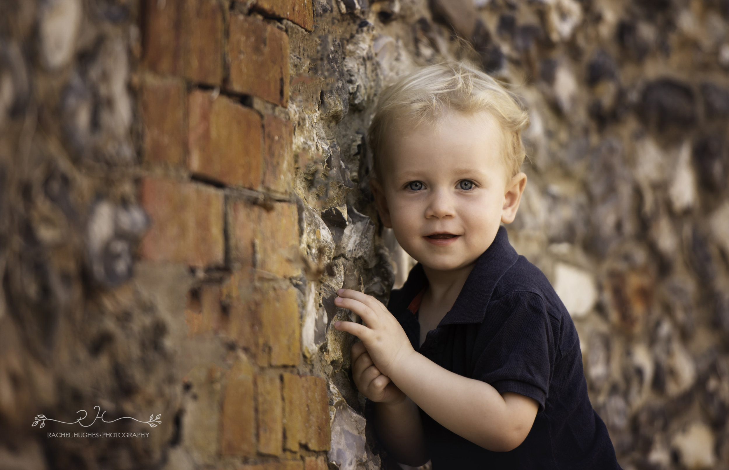 Jersey photographer - boy posing against wall
