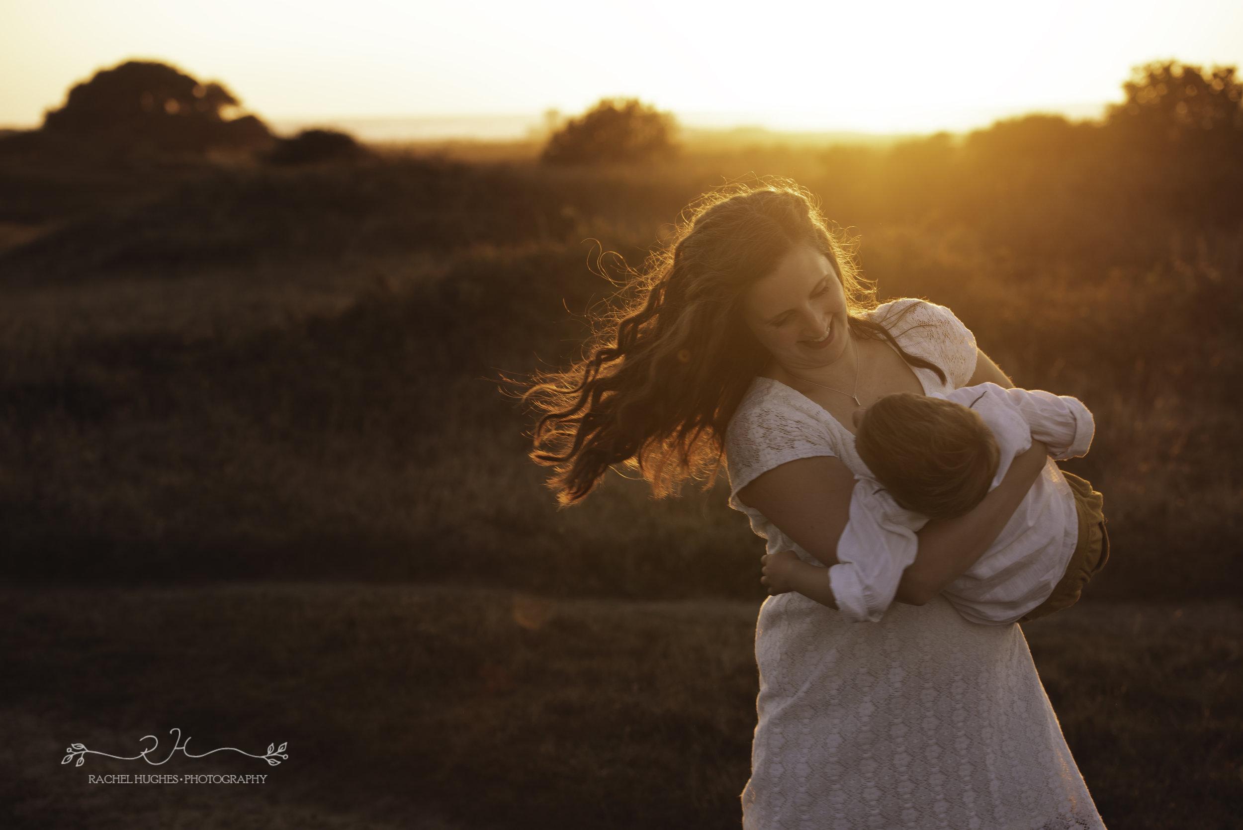 Jersey photographer - mum swinging son in sunset