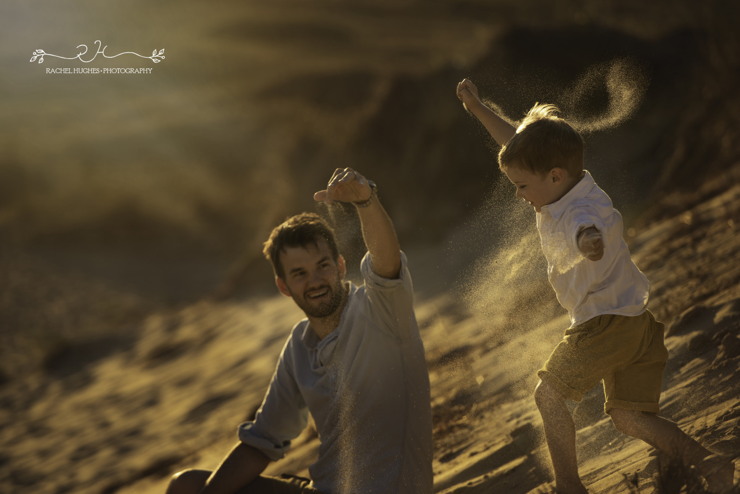 Jersey photographer - boy playing with sand at St Ouens