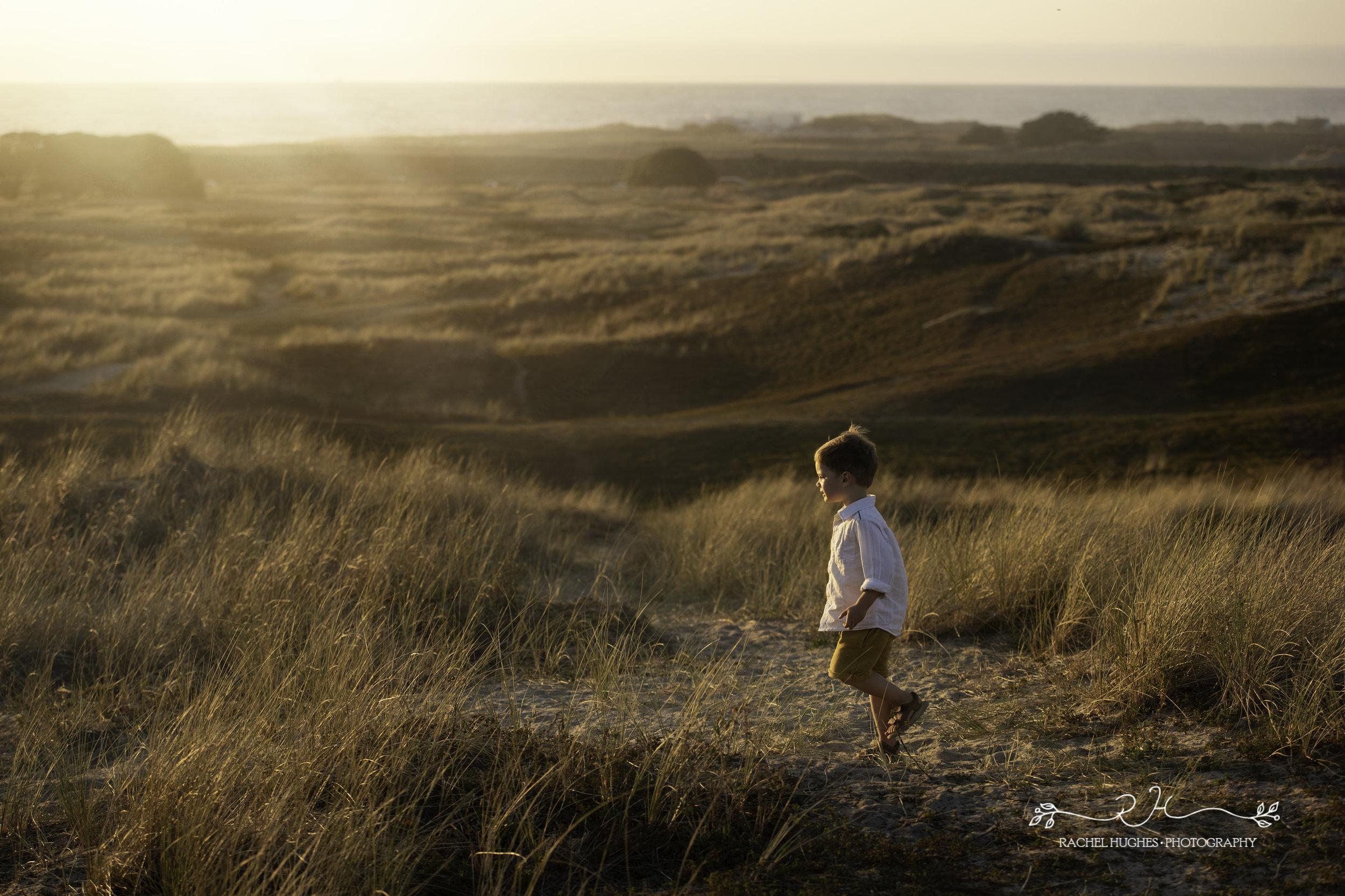 Jersey photographer - boy at St Ouen's sand dune sunset