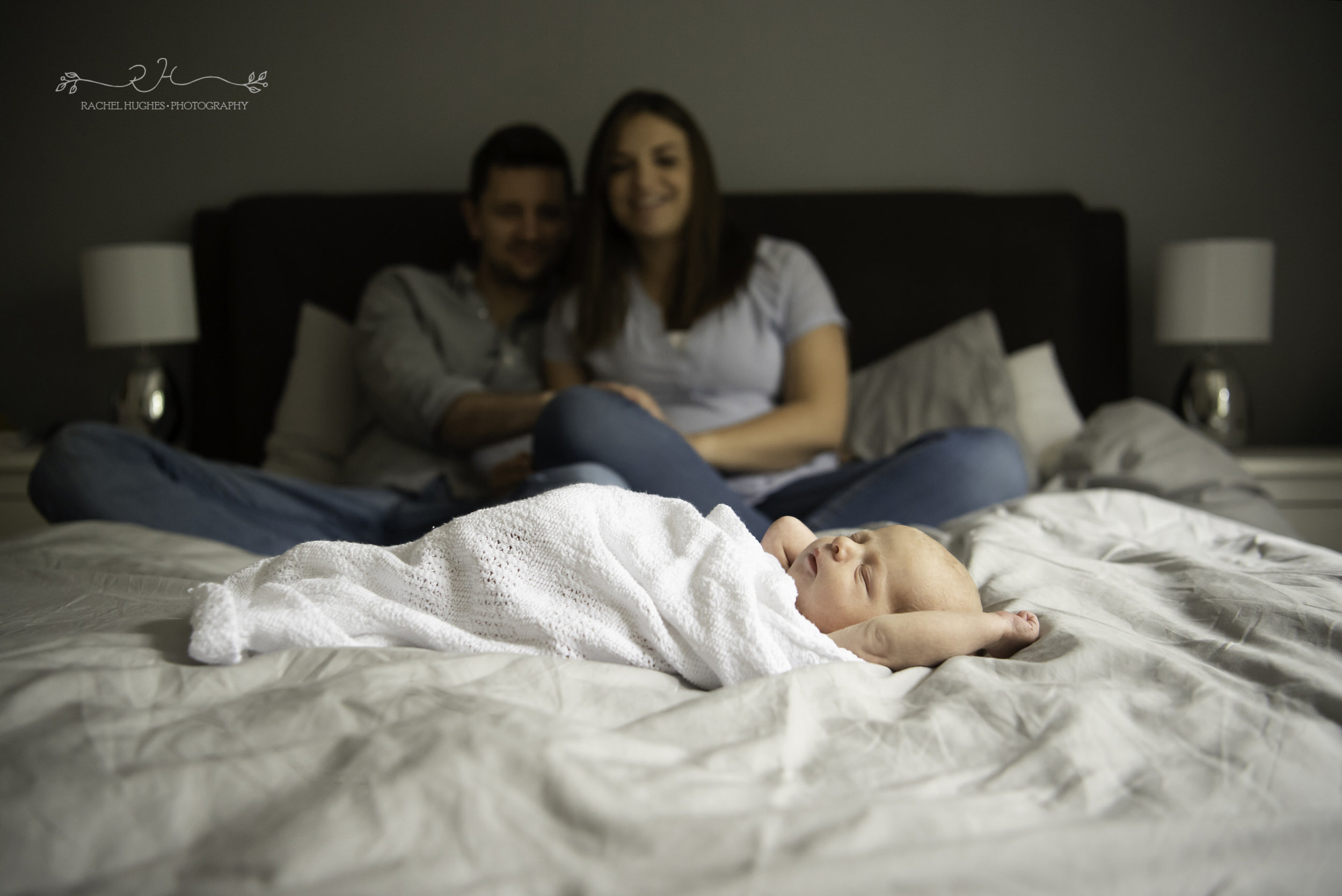 Jersey photographer - newborn baby sleeping at home on bed