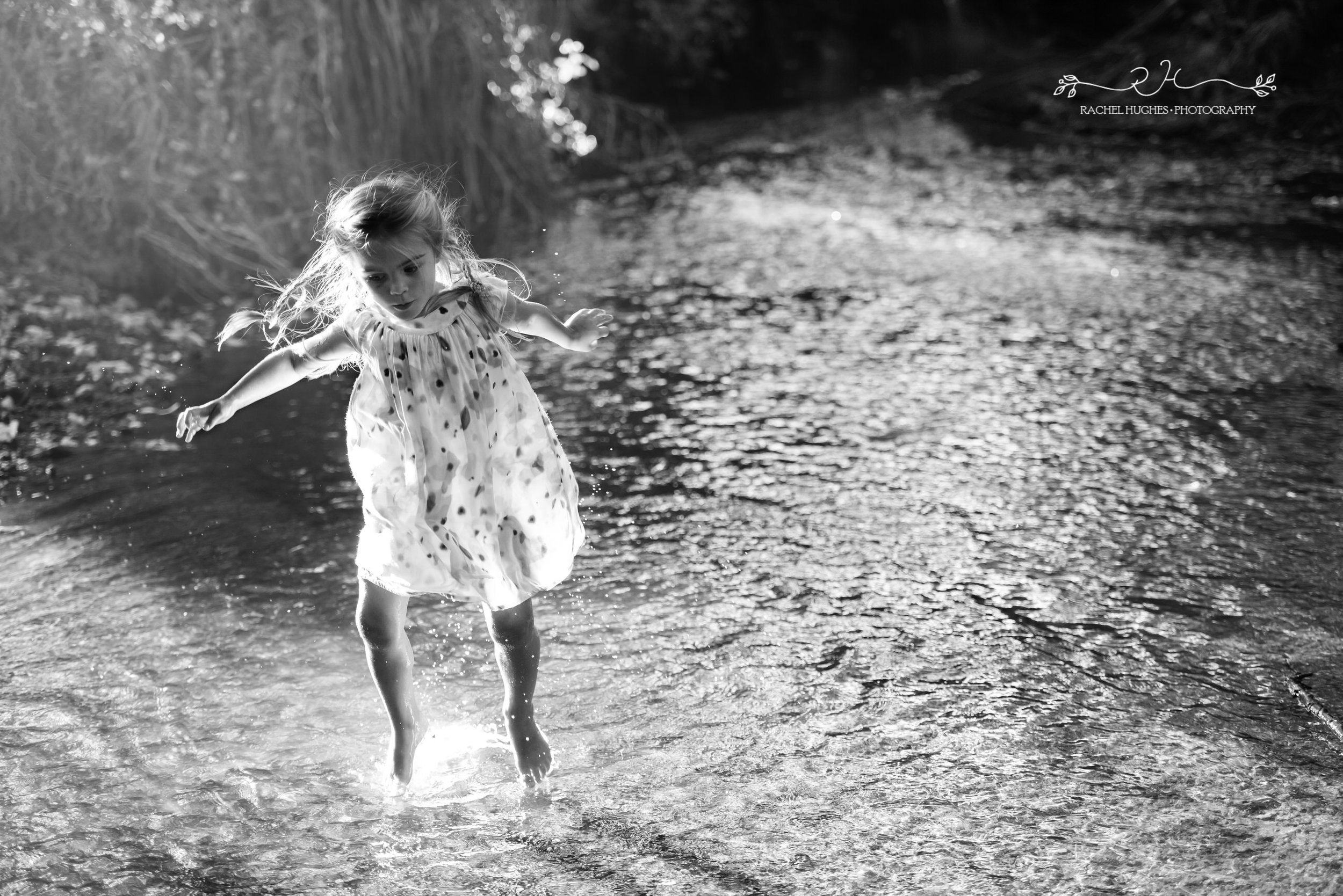 Jersey photographer - girl jumping in stream
