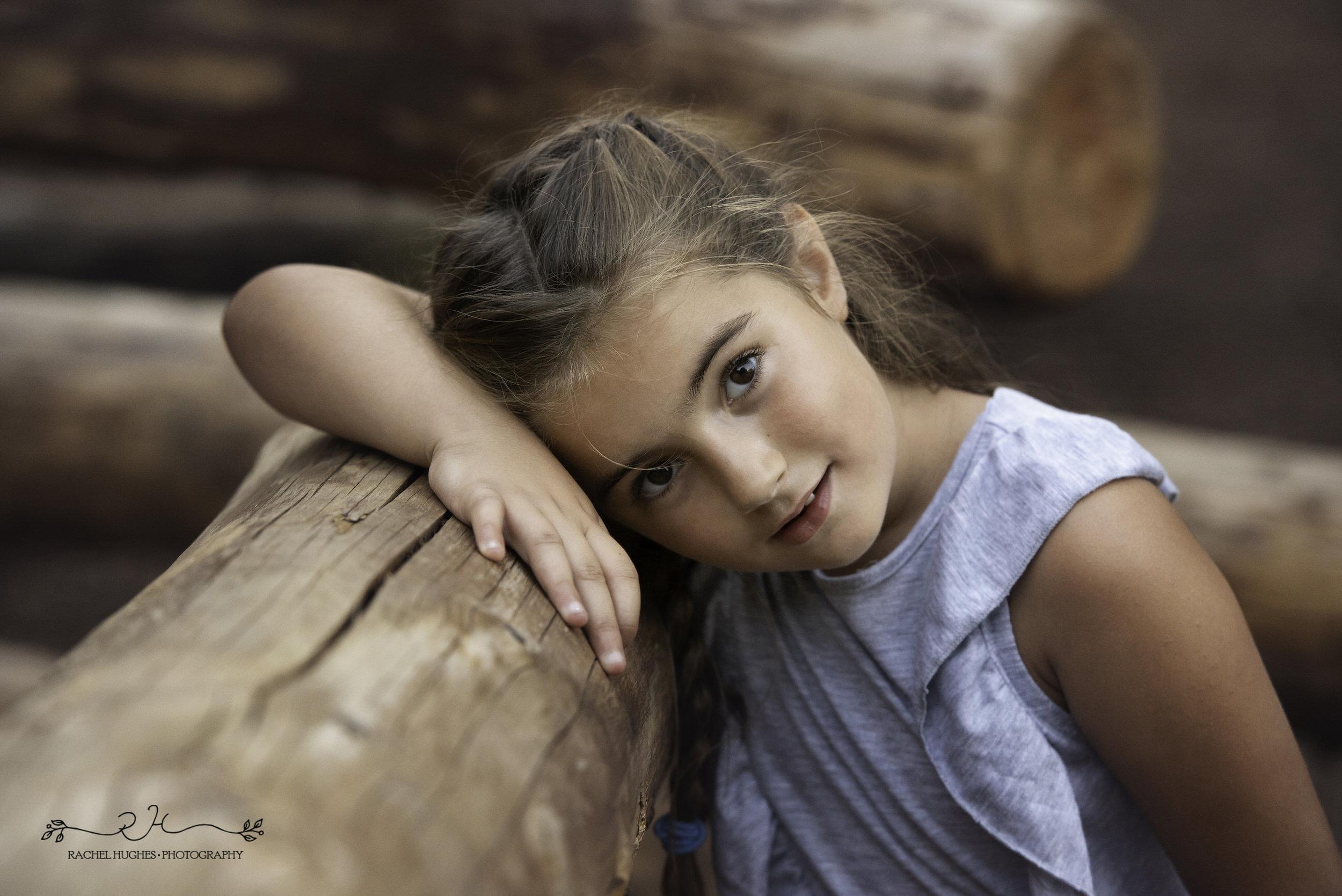 Jersey photographer - portrait of girl on climbing frame