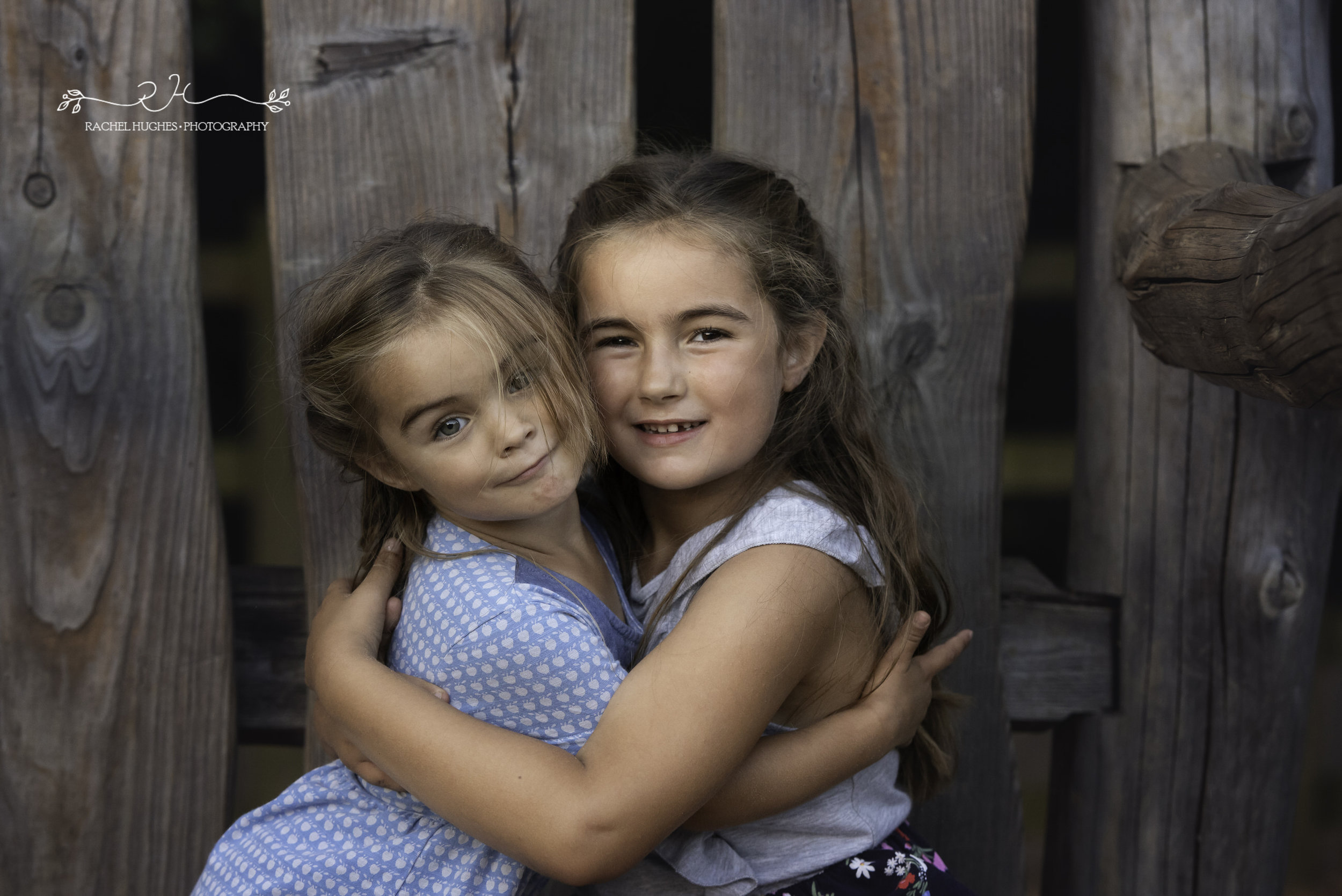 Jersey photographer - sister's embrace in park