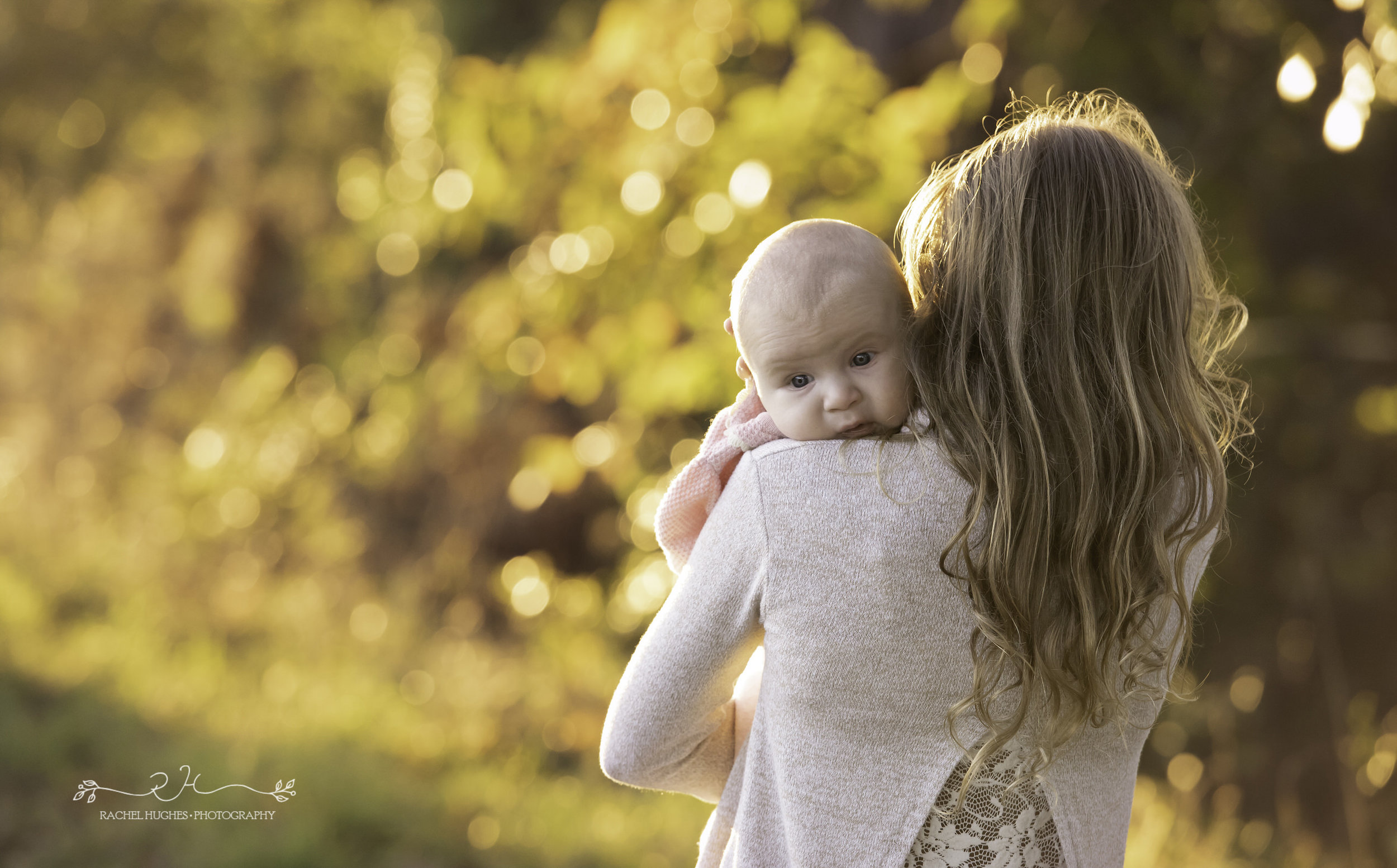 Jersey photographer - baby in her sister's arms