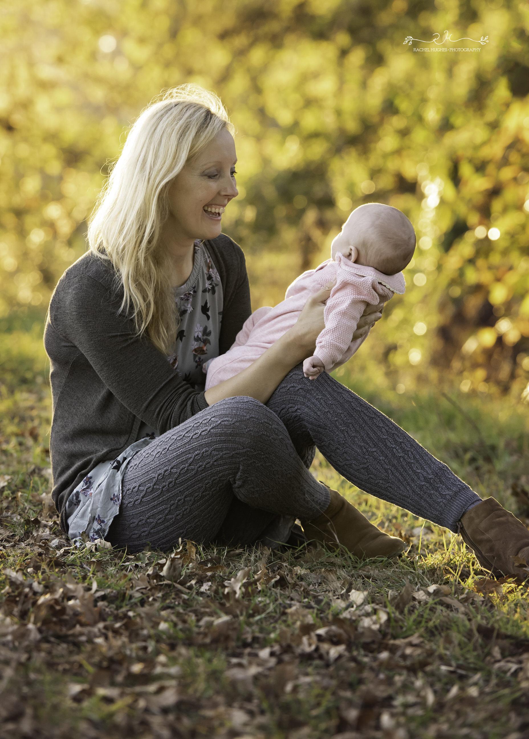 Jersey photographer - mum cradling baby in autumn