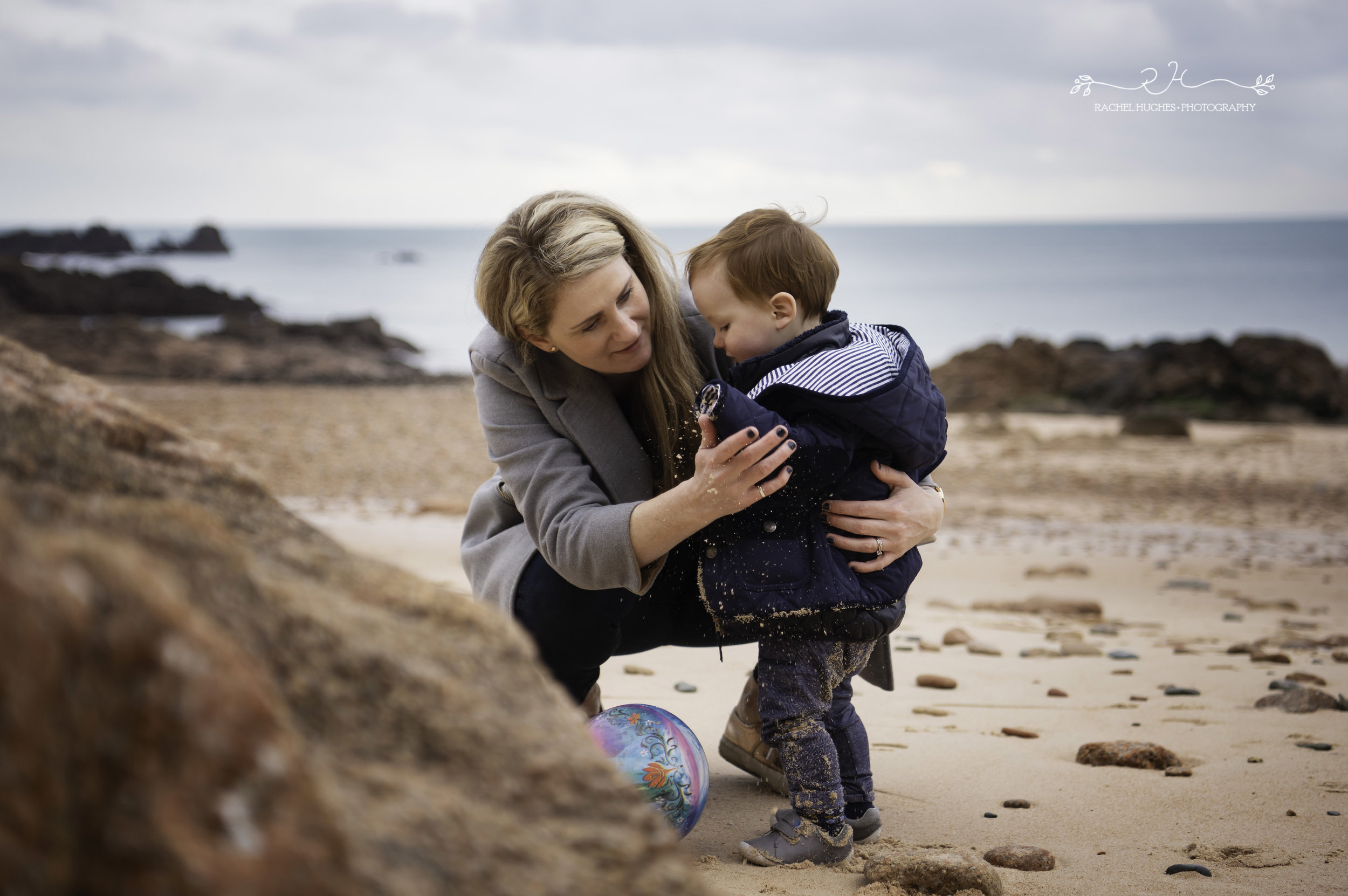 Jersey photographer: mum dusting sand off son