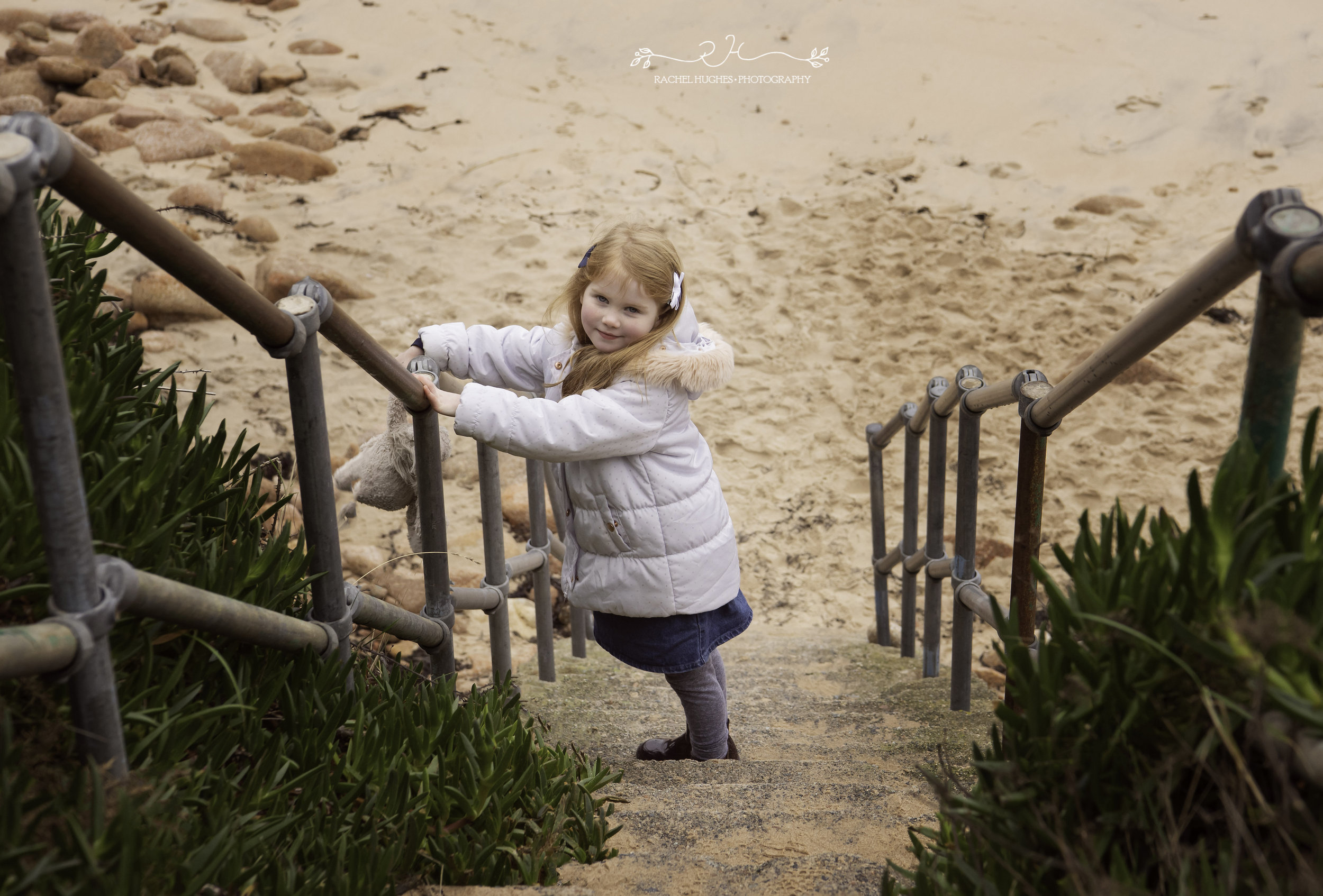 Jersey photographer: girl on steps at Portelet Bay