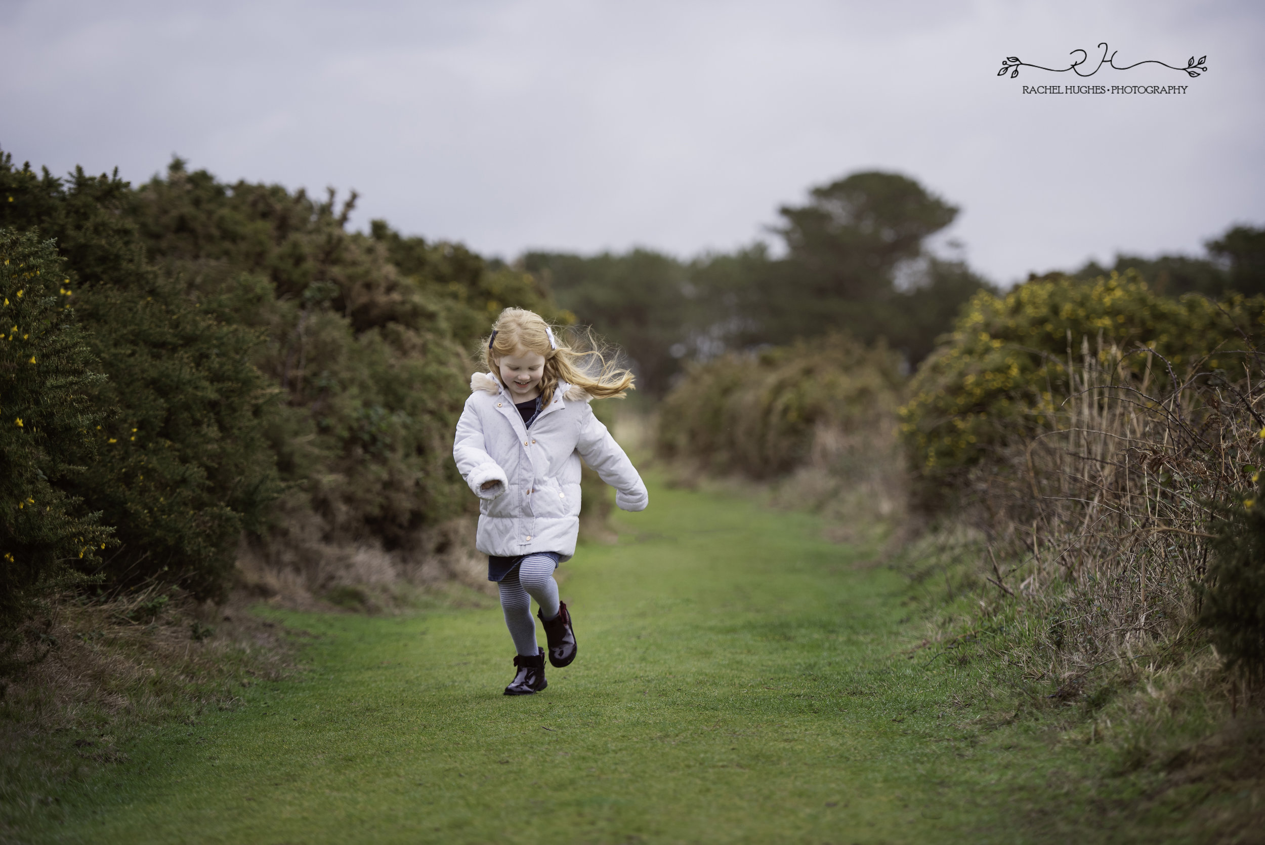 Jersey photographer: girl running at Portelet Common