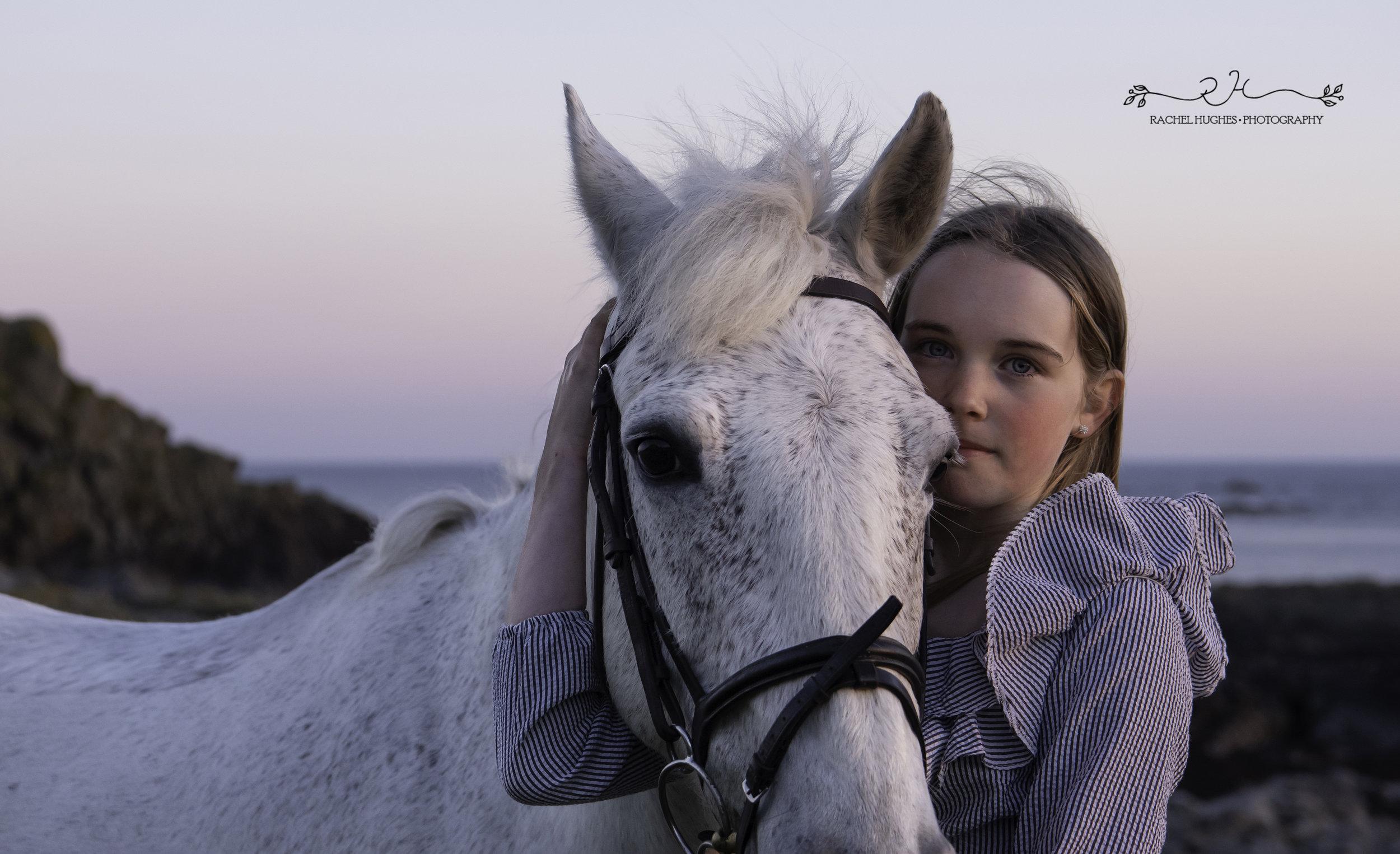 Jersey photographer - girl holding horse close