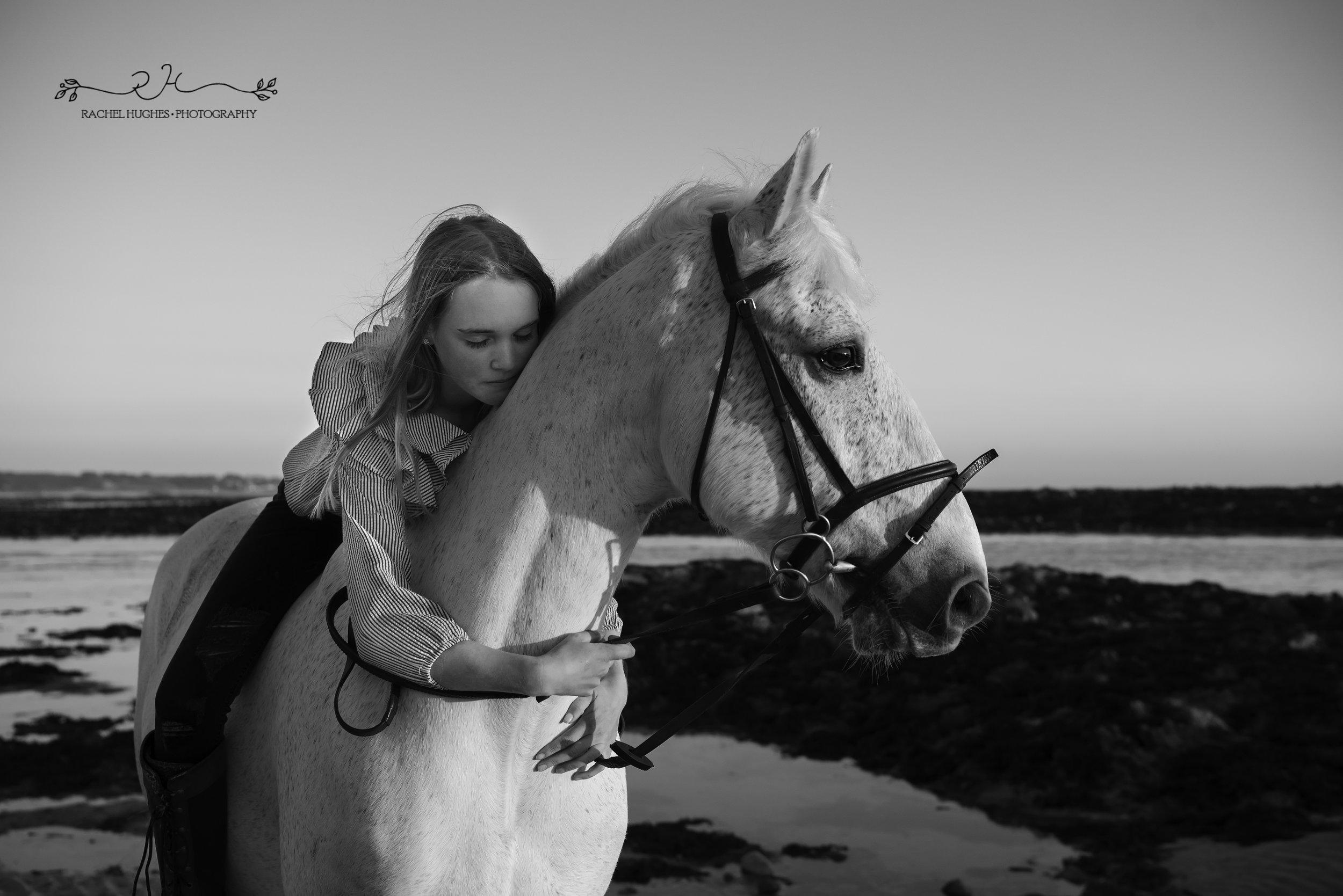 Jersey photographer - girl hugging horse at beach